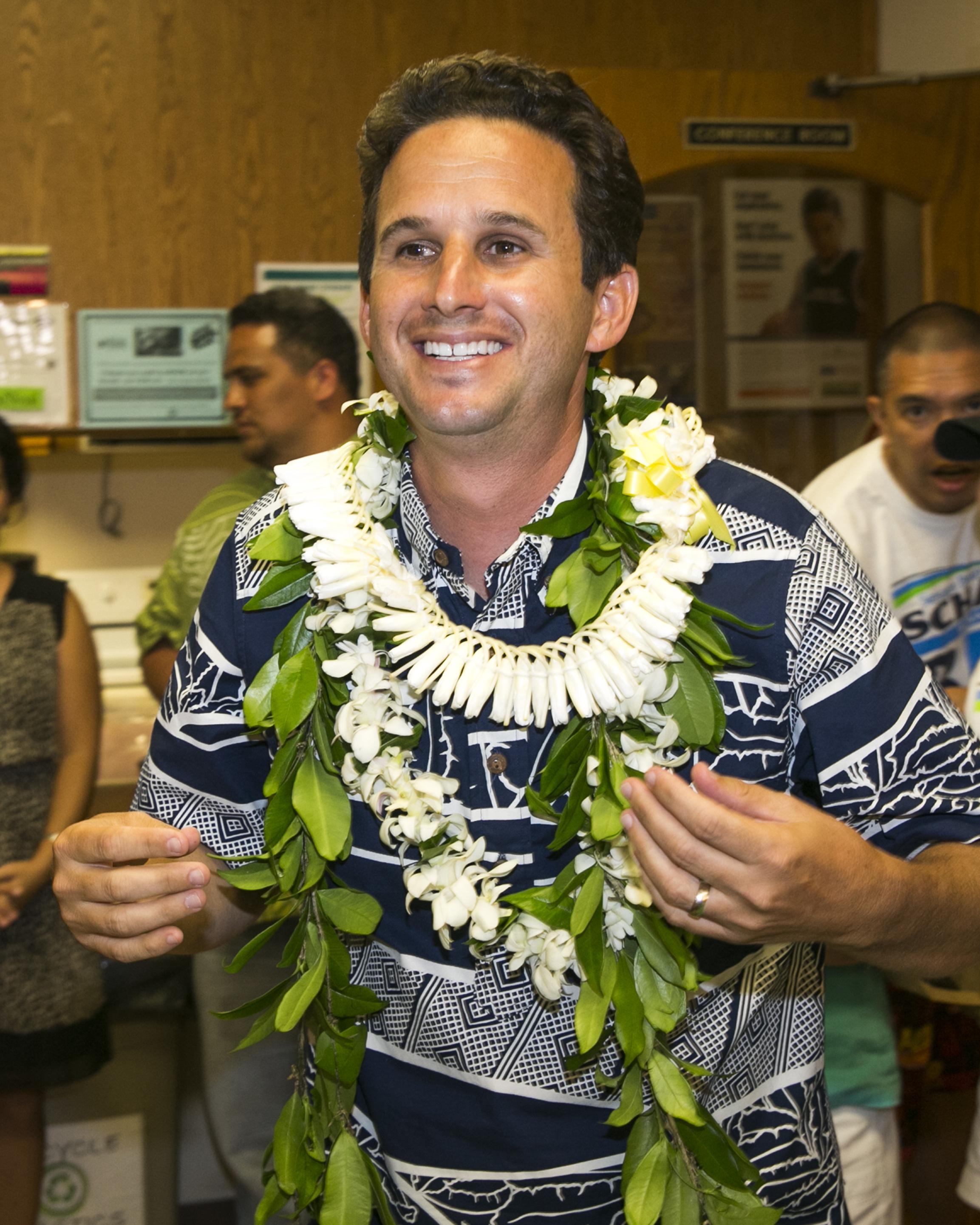 US Sen. Brian Schatz celebrates after defeating fellow Democrat Colleen Hanabusa to retain his senate seat on Aug. 15, 2014 in Hilo, Hawaii.