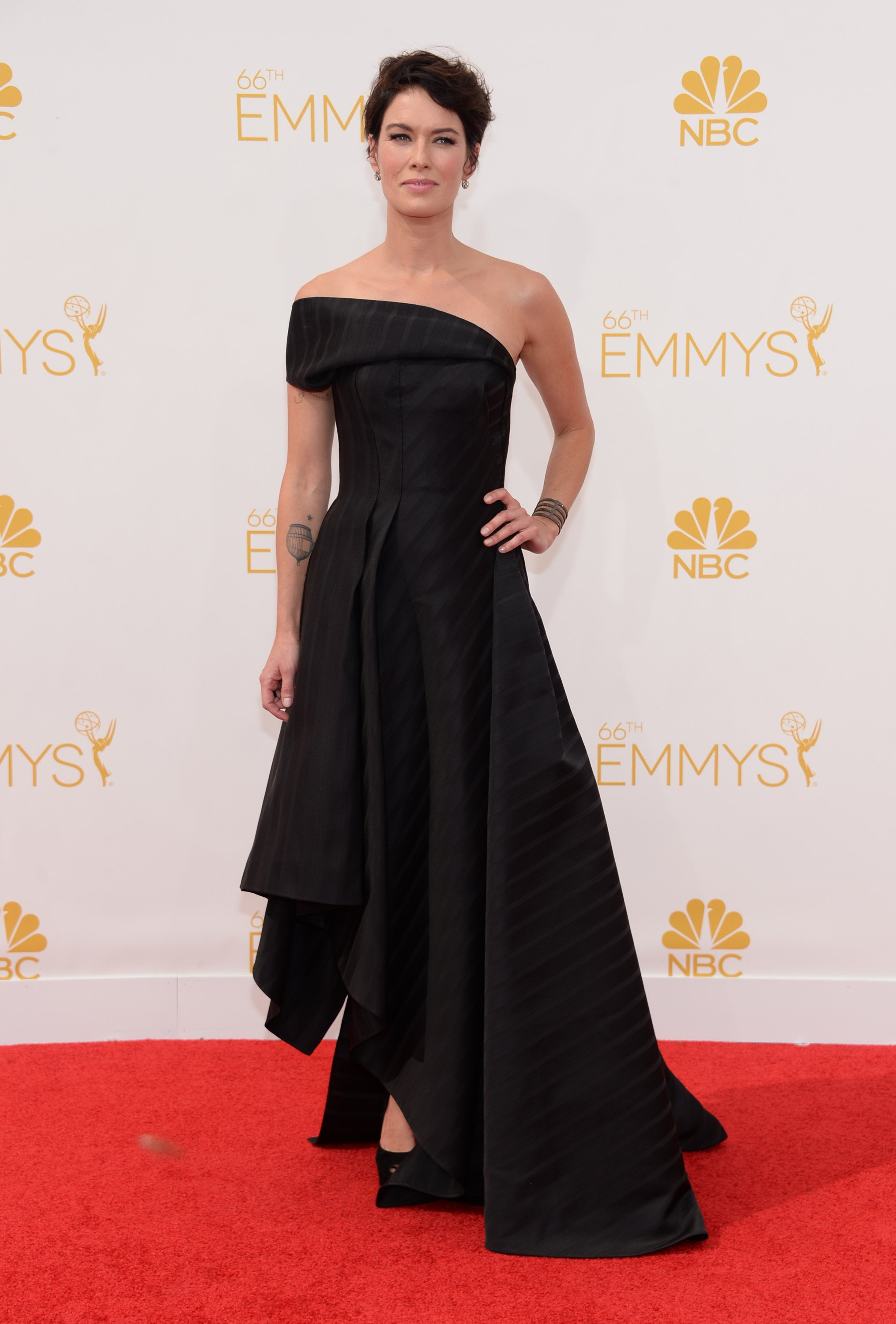 Lena Headey arrives at the 66th Primetime Emmy Awards at the Nokia Theatre L.A. Live on Monday, Aug. 25, 2014, in Los Angeles.