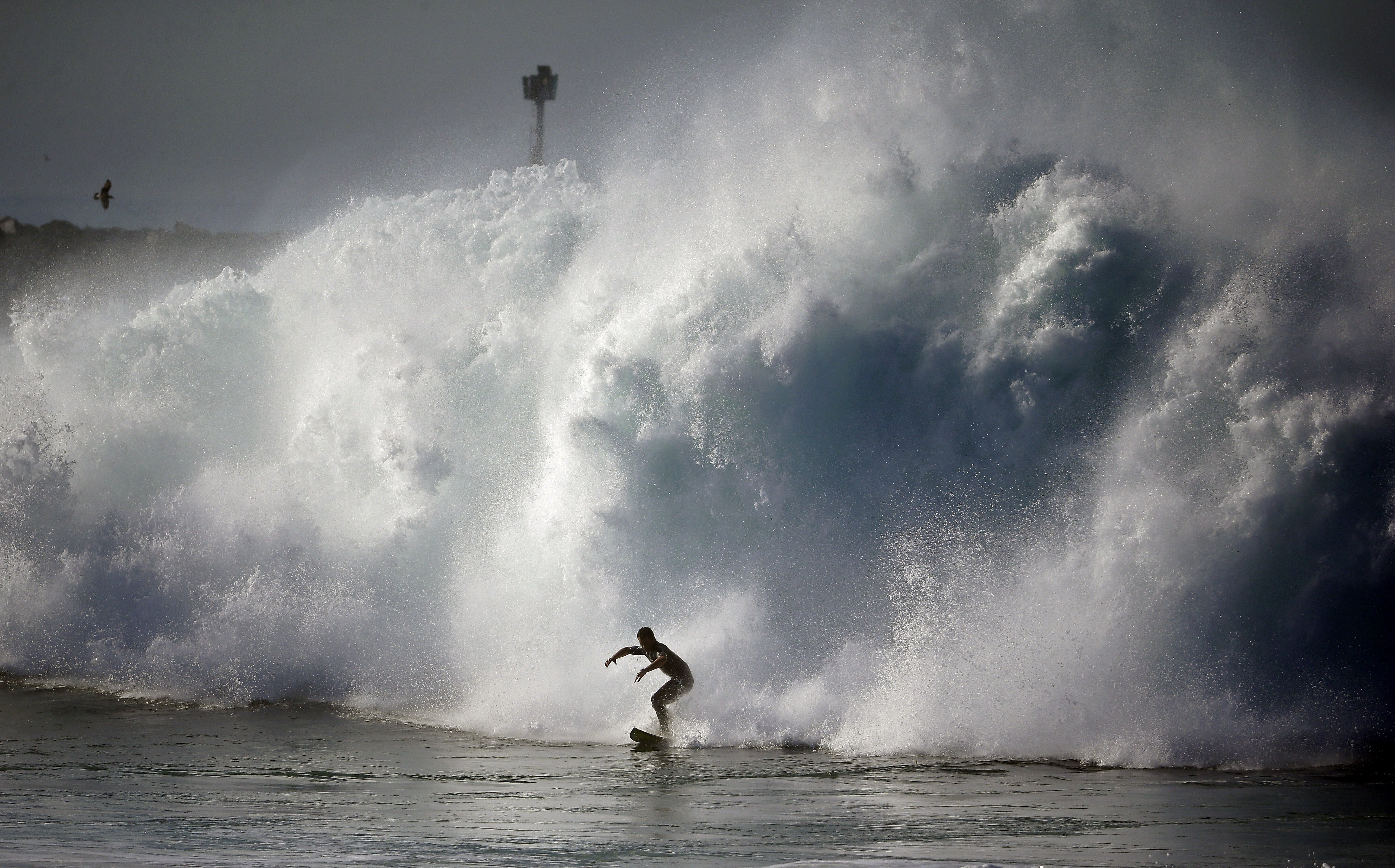 A surfer rides a wave at the wedge in Newport Beach, Calif. on Aug. 27, 2014. Southern California beachgoers experienced much higher than normal surf, brought on by Hurricane Marie spinning off the coast of Mexico.