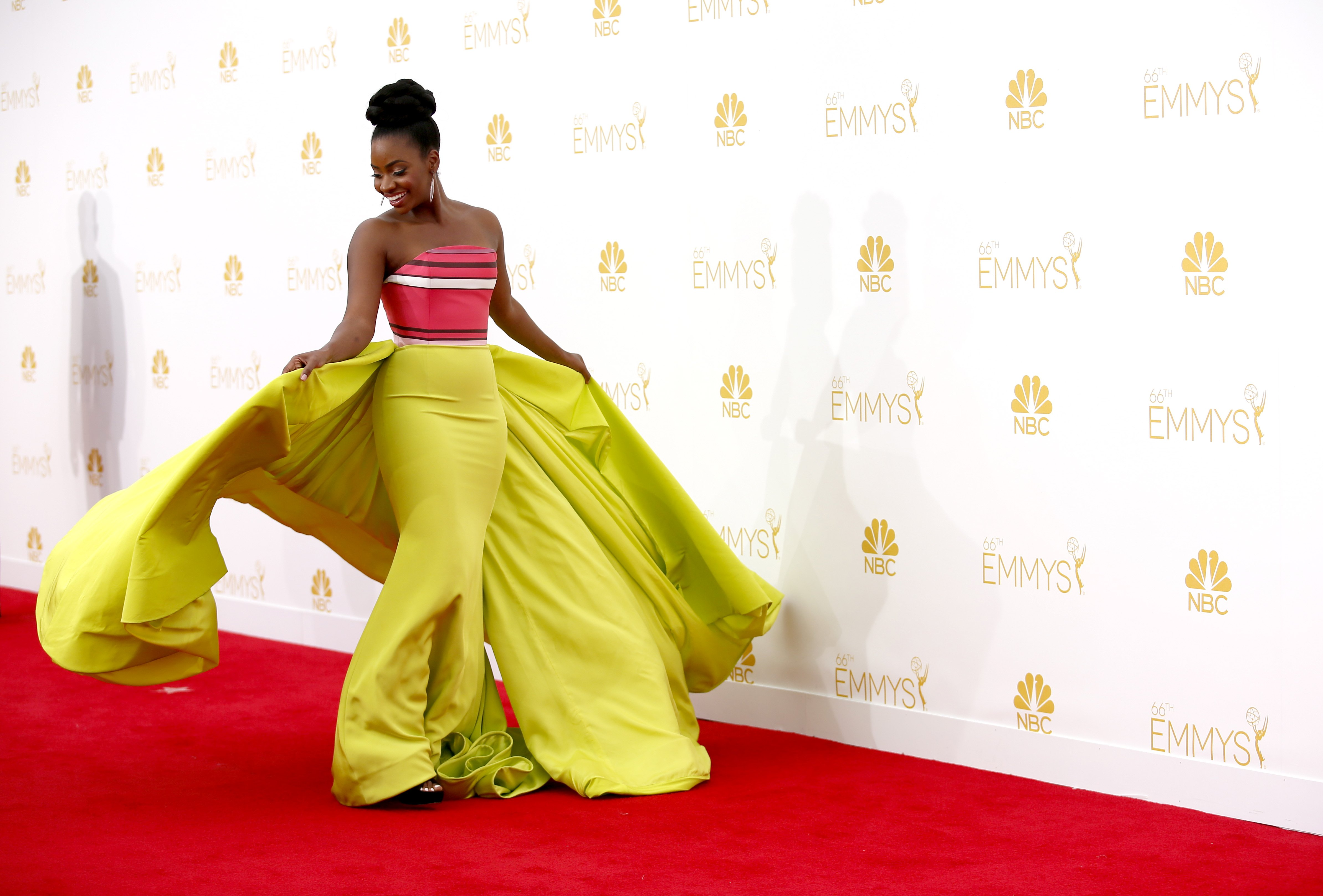 Teyonah Parris arrives at the 66th Primetime Emmy Awards at the Nokia Theatre L.A. Live on Monday, Aug. 25, 2014, in Los Angeles.