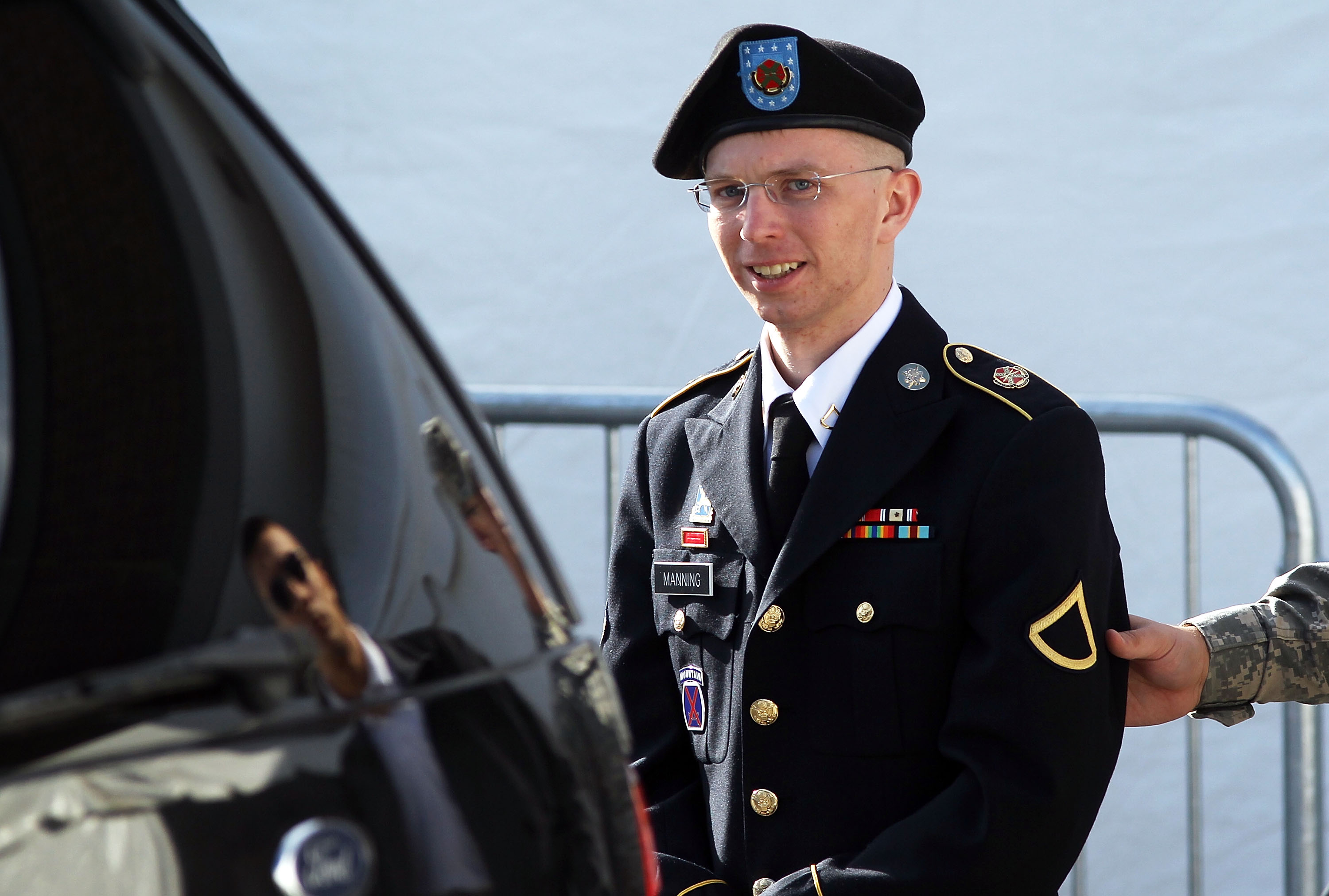 U.S. Army Private Bradley Manning is escorted as he leaves a military court at the end of the first of a three-day motion hearing June 6, 2012 in Fort Meade, Maryland.