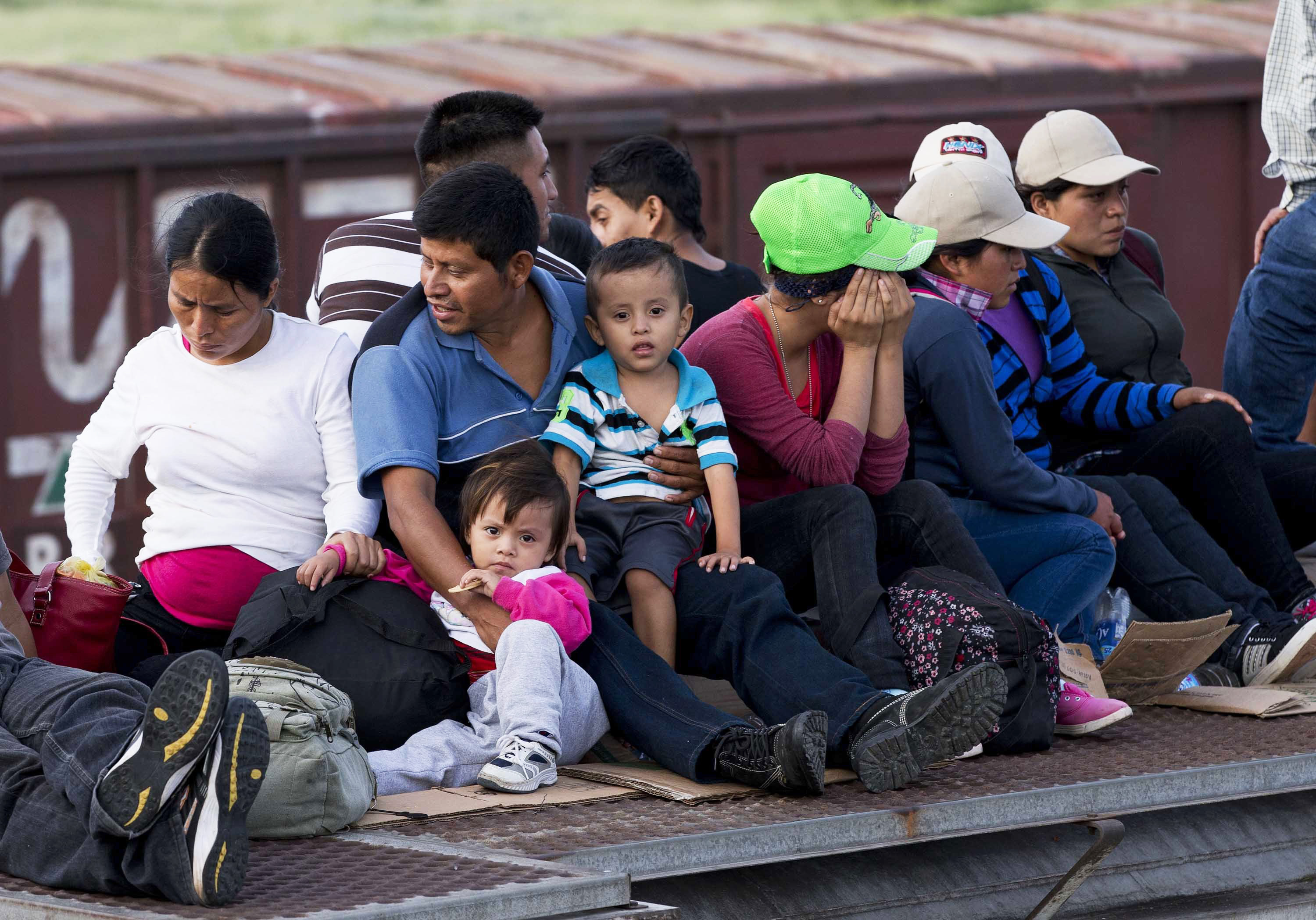 Central American migrants ride a freight train during their journey toward the U.S.-Mexico border in Ixtepec, Mexico on July 12, 2014.