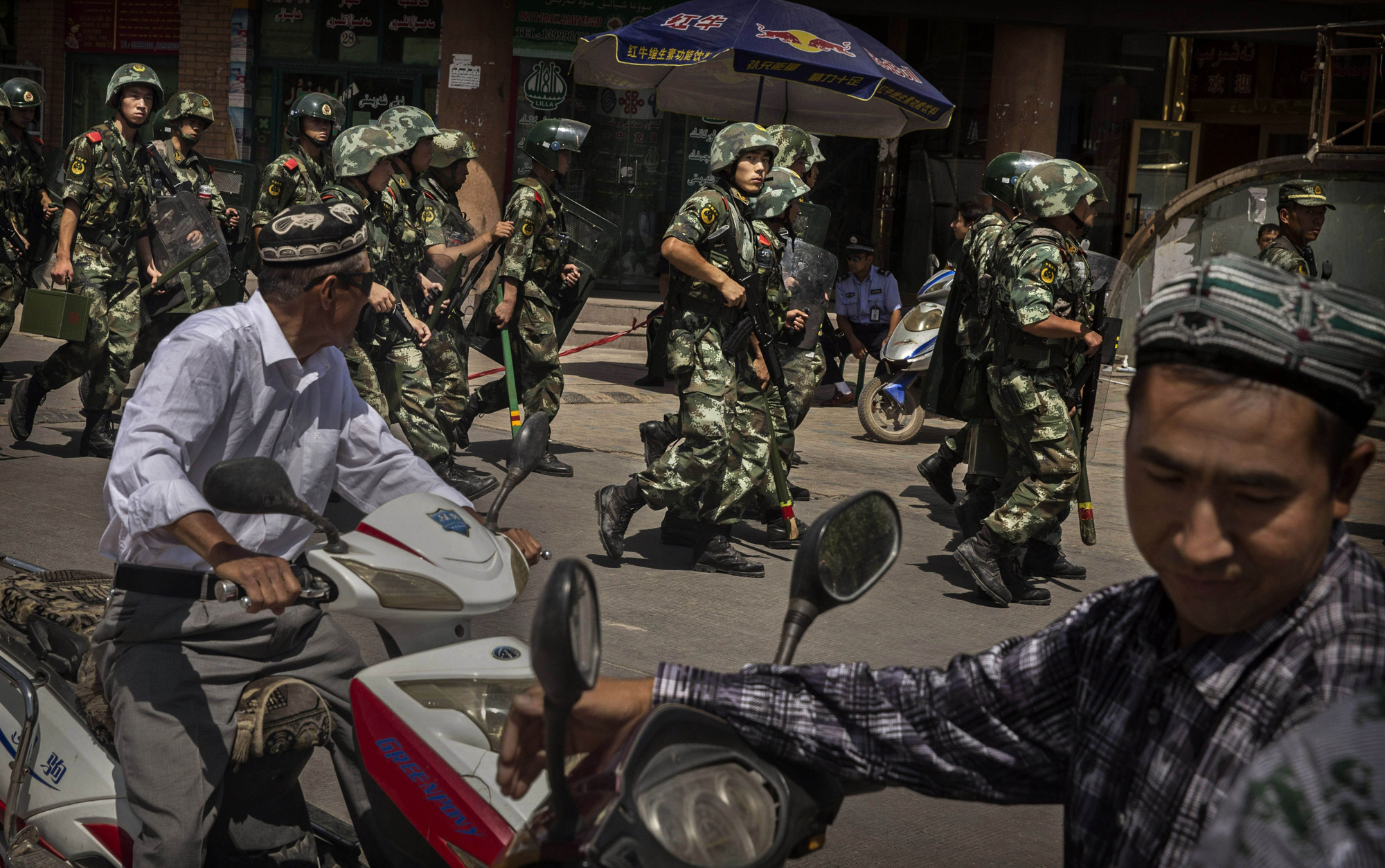 Chinese soldiers in riot gear secure the area outside the Id Kah Mosque, after Imam Jumwe Tahir was killed by assailants following early morning prayers on July 30, 2014 in old Kashgar.
