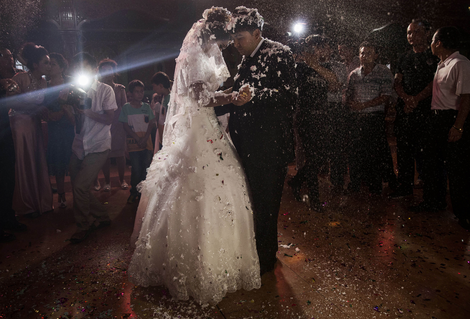 A Uighur couple have their first dance at their wedding celebration after being married on August 2, 2014 in Kashgar.