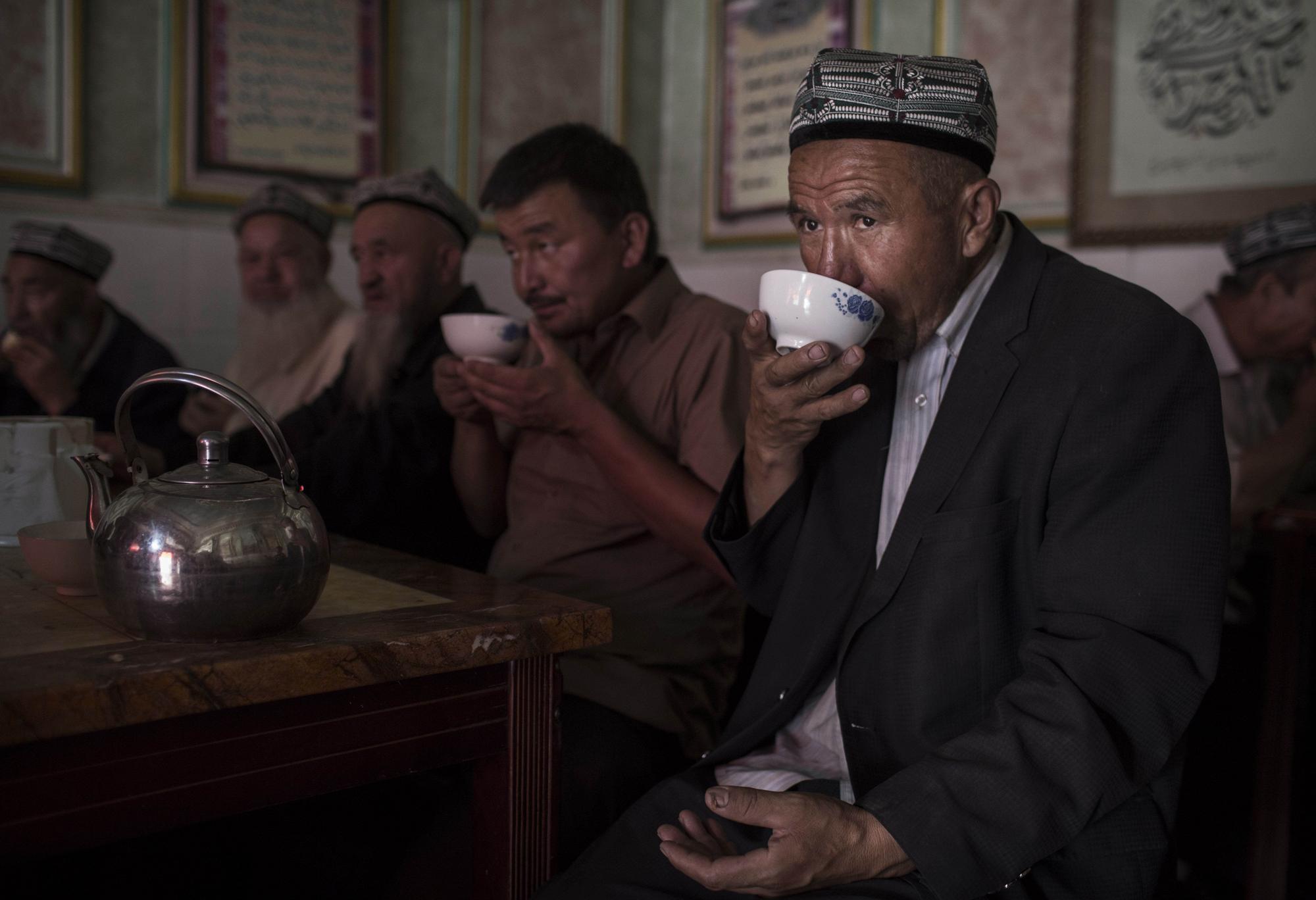 A Uighur man drinks tea at a restaurant on August 1, 2014 in old Kashgar.