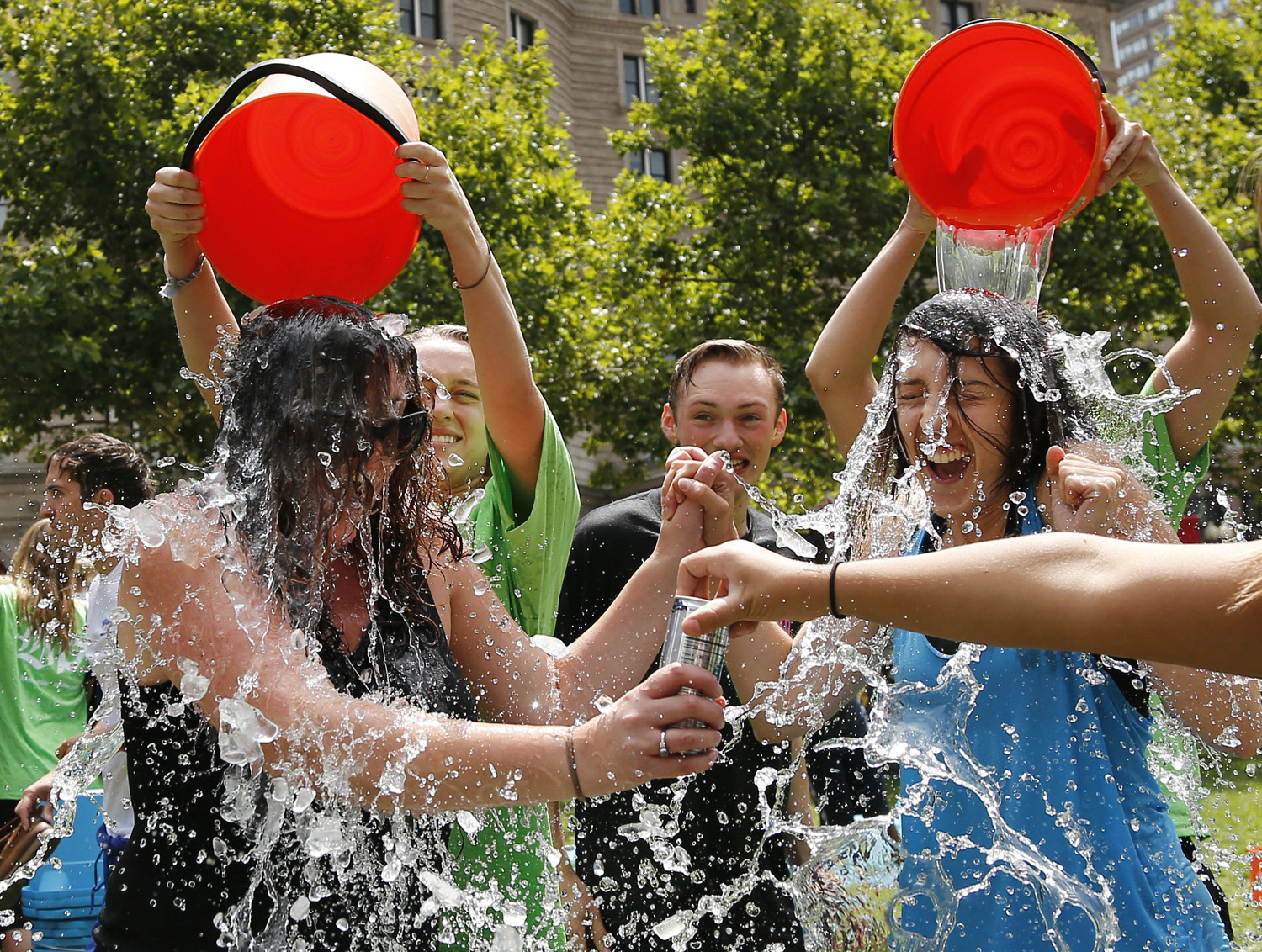 Two women get doused during the ice bucket challenge at Boston's Copley Square on Aug. 7, 2014.