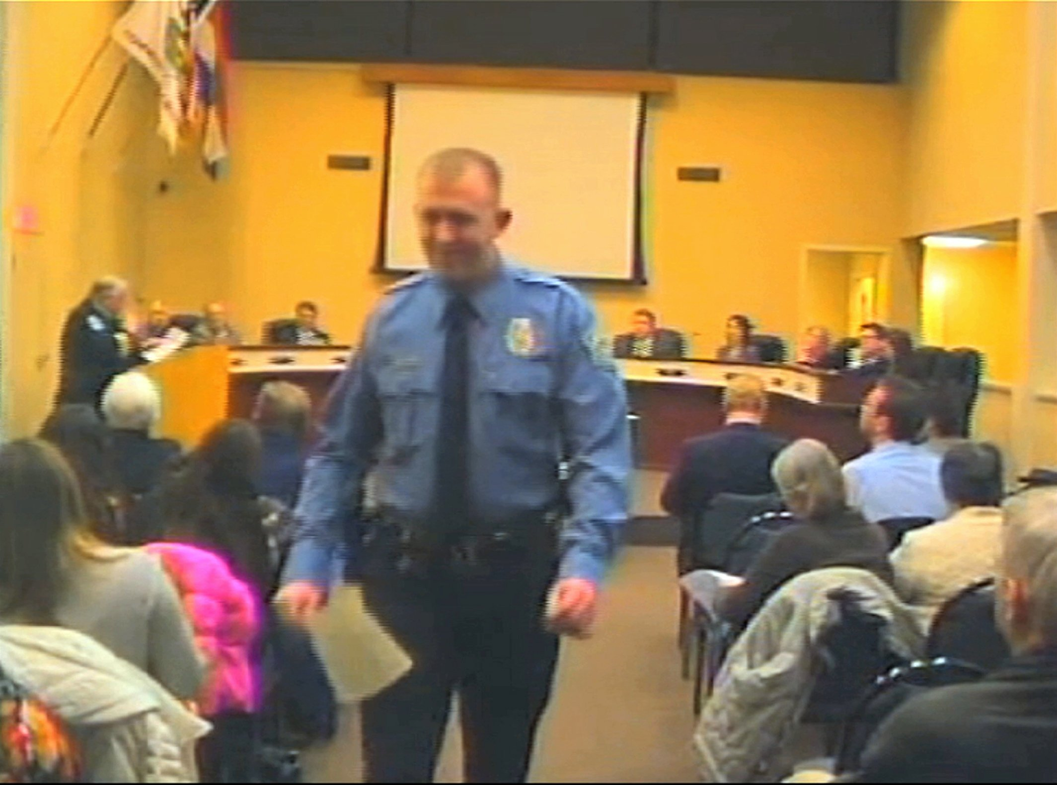 Officer Darren Wilson attends a city council meeting in Ferguson on Feb. 11, 2014 in this image released from video by the City of Ferguson, Mo.