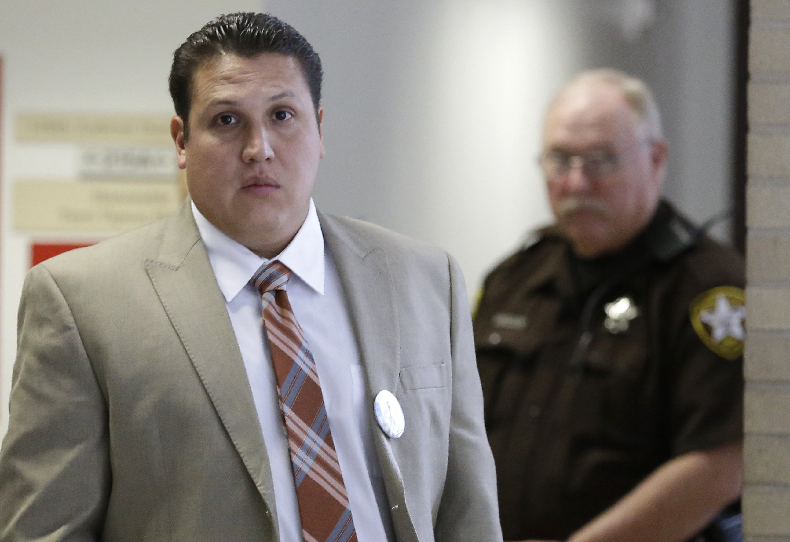 David Barajas leaves the courtroom during a break in his murder trial Aug. 20, 2014, in Angleton, Texas. B