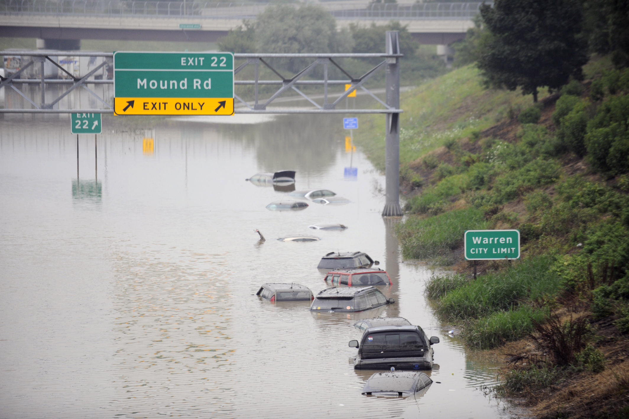 Cars are stranded along a flooded stretch of I-696 at the Warren, Mich. city limits on Aug. 12, 2014. Police divers are searching for anyone trapped in their vehicles. Warren Mayor James Fouts said roughly 1,000 vehicles had been abandoned in floodwaters.