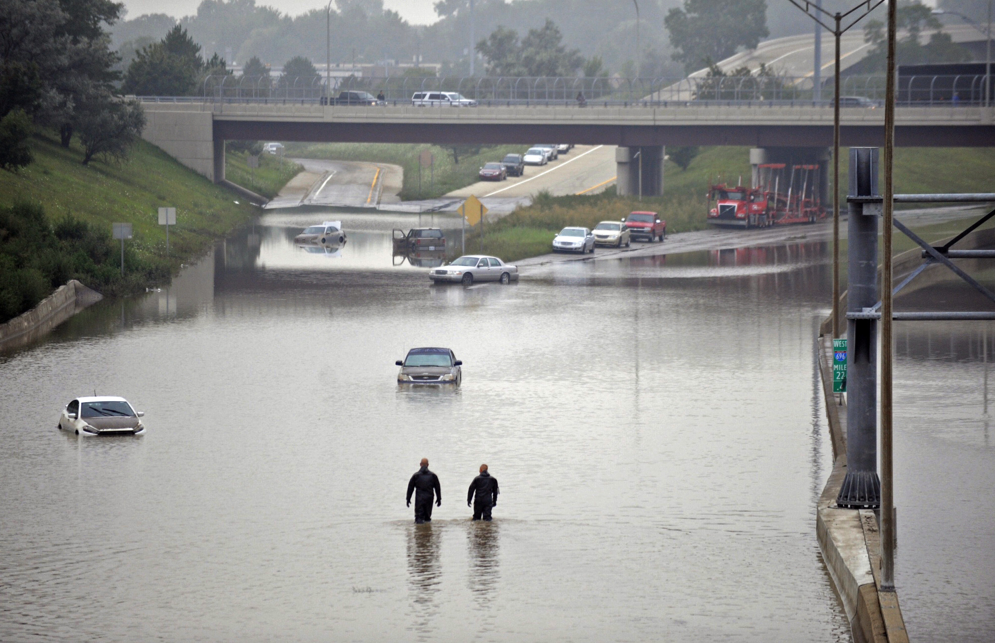 Cars are stranded along a flooded stretch of Interstate 696 at the Warren, Mich., city limits on Aug. 12, 2014. Police divers are searching for anyone trapped in their vehicles. Warren Mayor James Fouts said roughly 1,000 vehicles had been abandoned in floodwaters.