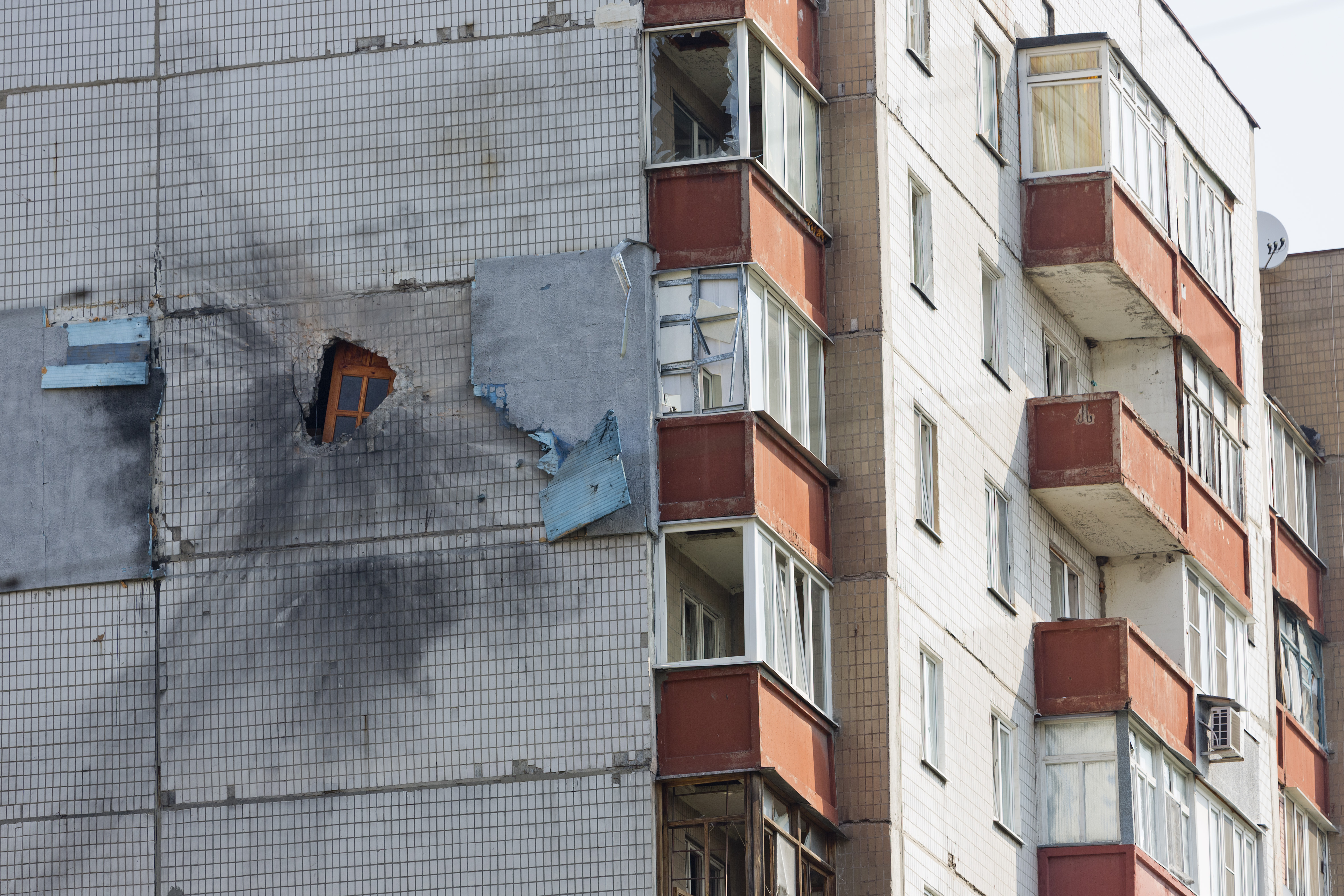 Shells damage a residential building on August 11, 2014 in Donetsk, Ukraine.