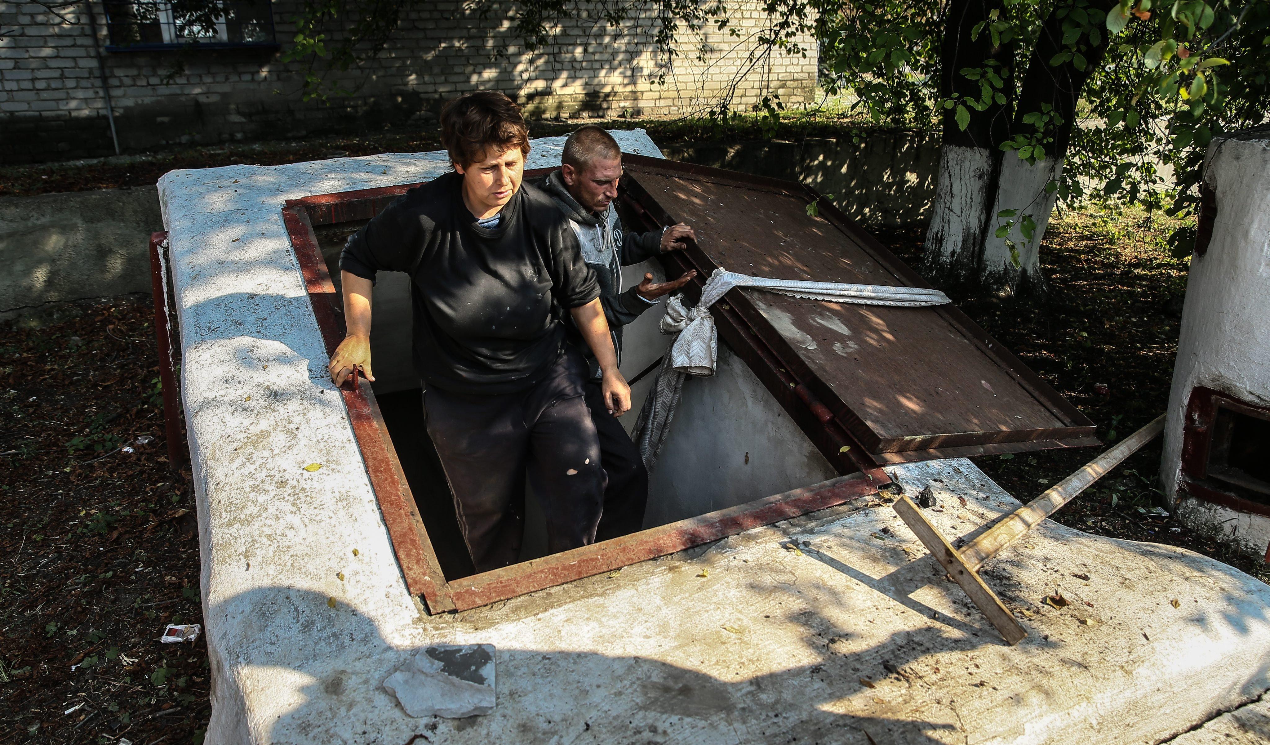 Vera and Vladimir leave a shelter in Ilovaysk, some 50km from Donetsk, eastern Ukraine on August 14, 2014.