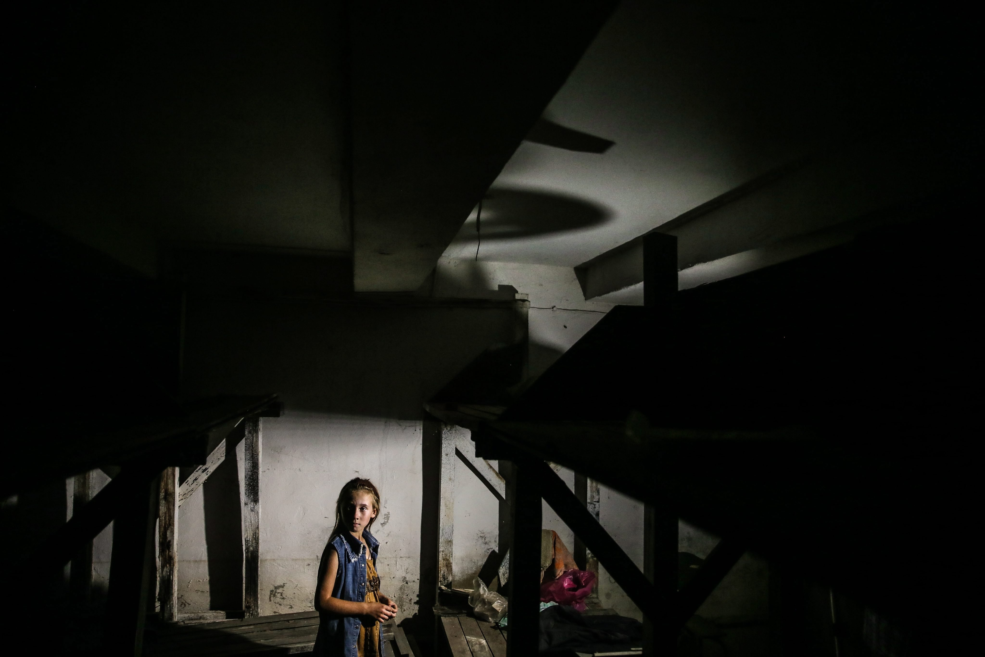 Tatiana, 9, stands in a shelter in Ilovaysk, some 50km from Donetsk, eastern Ukraine on August 14, 2014.