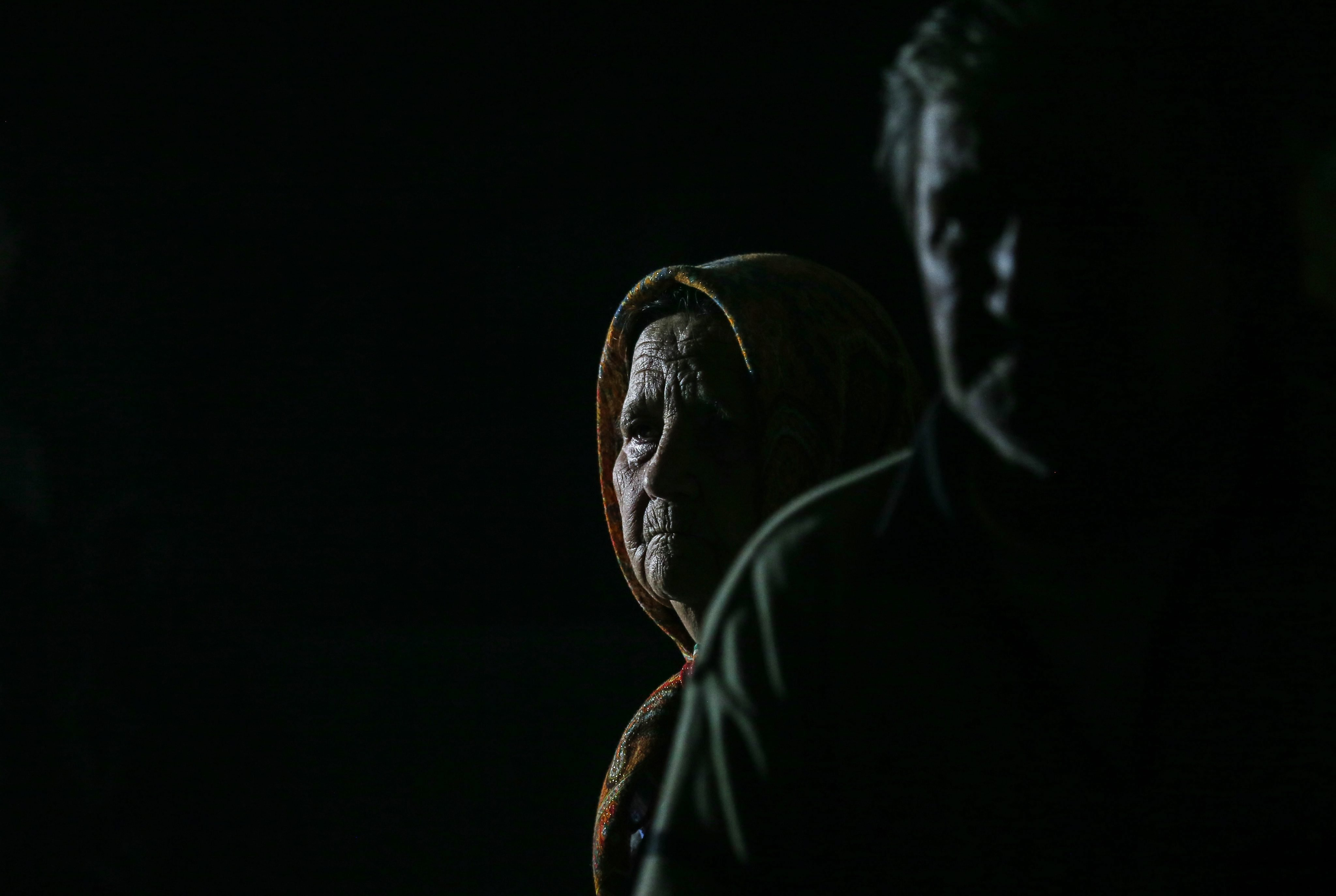Local people sit in a shelter in Ilovaysk, some 50km from Donetsk, eastern Ukraine on August 14, 2014.