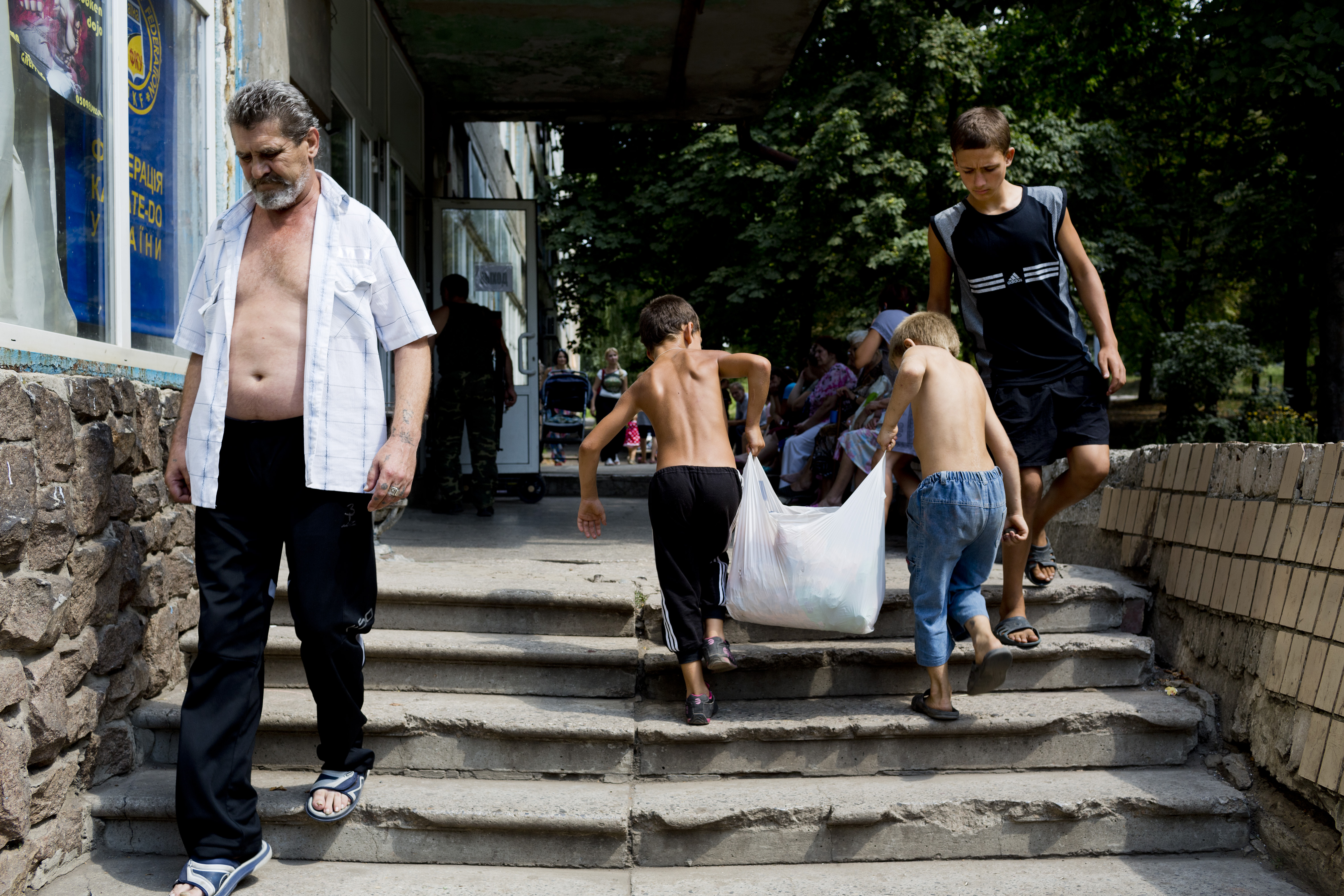 People deliver aid for refugees occupying a building of the National University of Donetsk as shelter from conflict on August 12, 2014 in Donetsk, Ukraine.