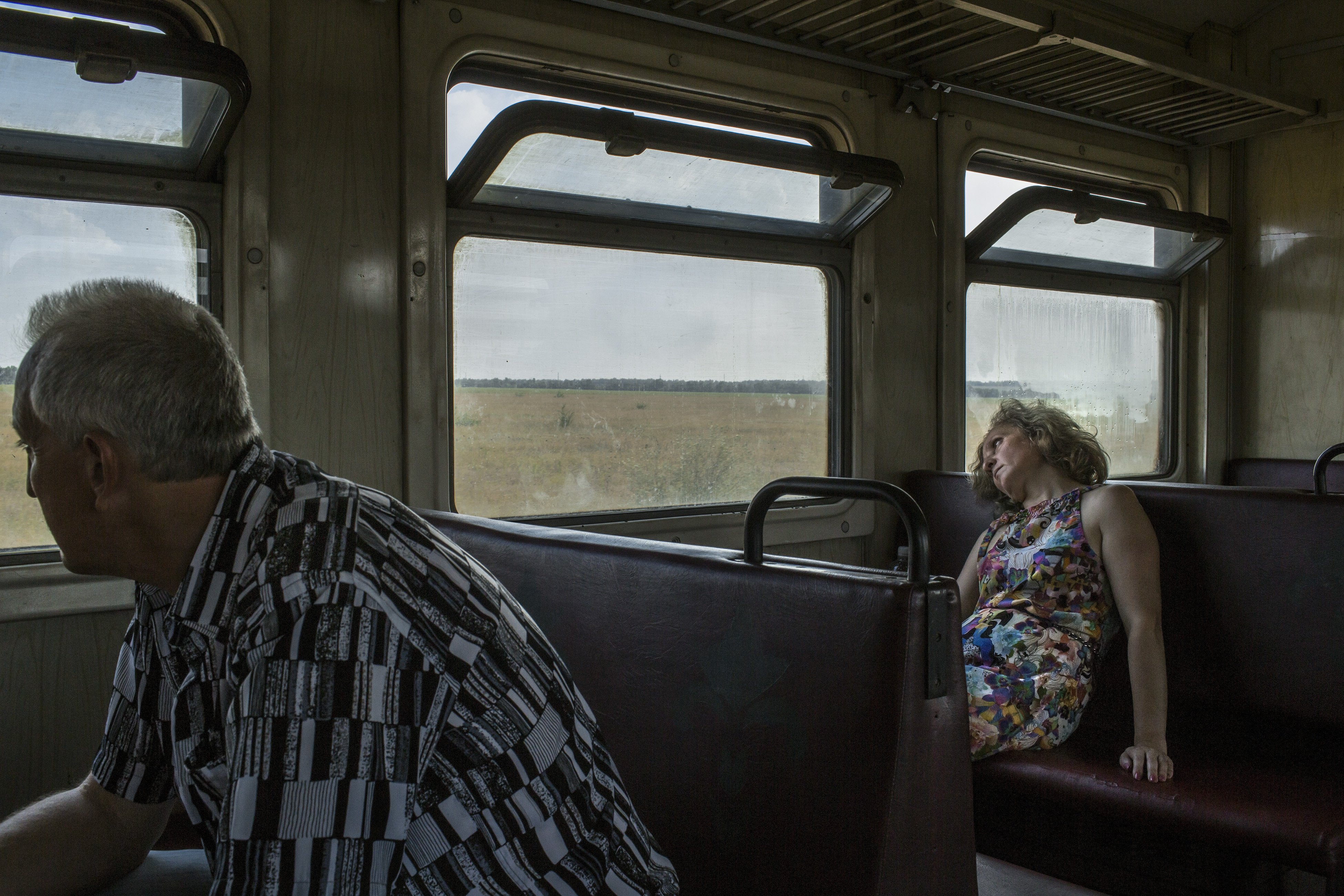 Passengers during a train trip from the village of Alchevsk towards Luhansk, Ukraine on August 13, 2014.
