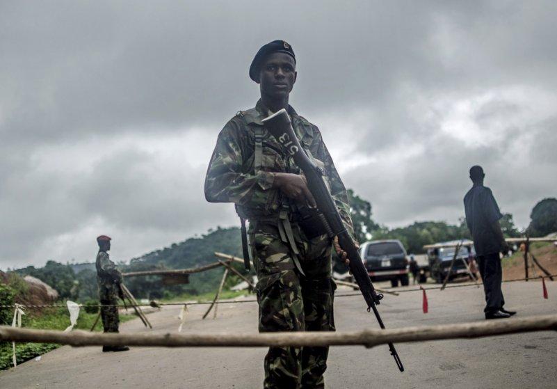 Aug. 8, 2014. Soldiers stand guard at a roadblock outside Kenema, Sierra Leone.