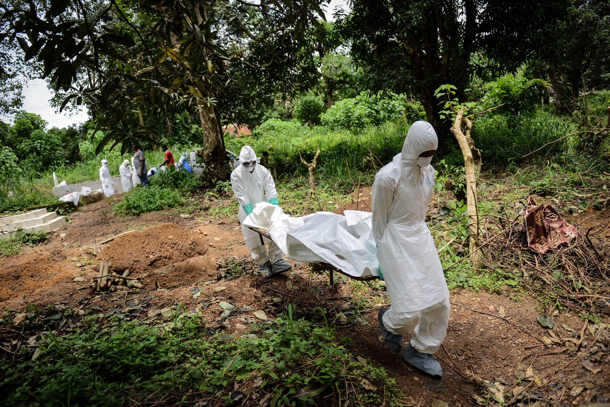 A group of young volunteers wear special uniforms for the burial of Ebola victims in Kenema, Sierra Leone on Aug. 24, 2014.