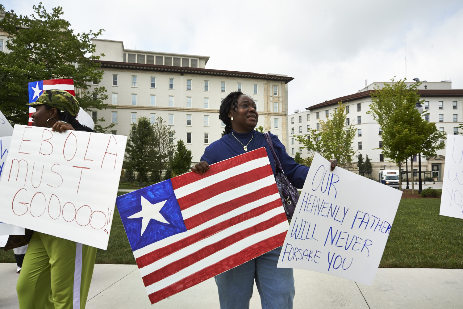 Garmai Kpardeh, a member of the Liberian Association of Metropolitan Atlanta rallying in front of Emory University Hospital, August 9.