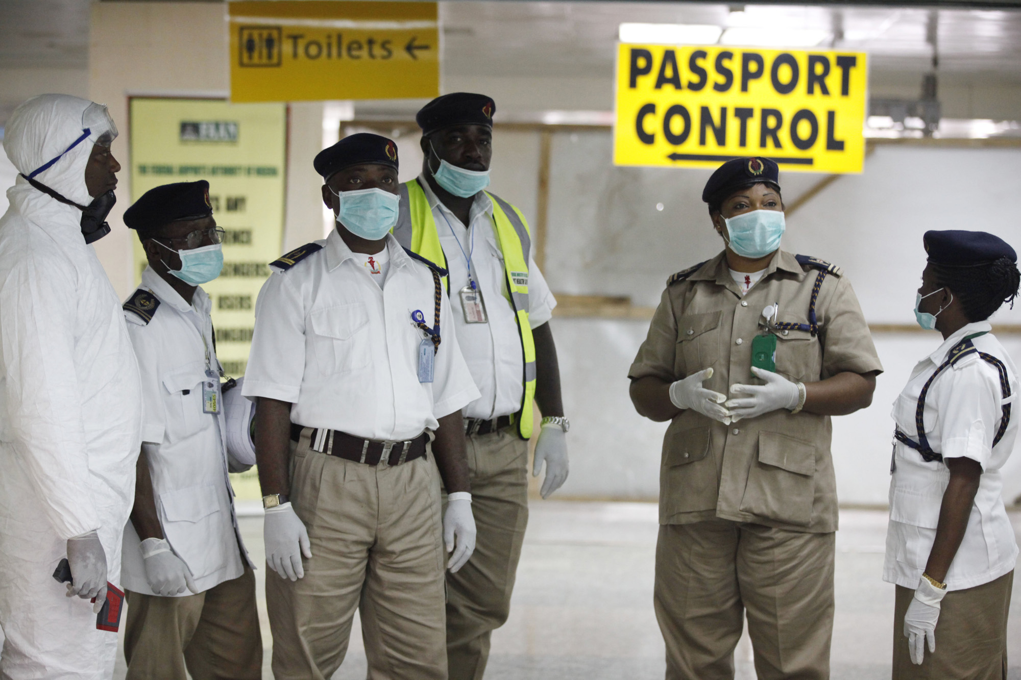 Nigeria health officials wait to screen passengers at the arrival hall of Murtala Muhammed International Airport in Lagos, Nigeria, Aug. 4, 2014.