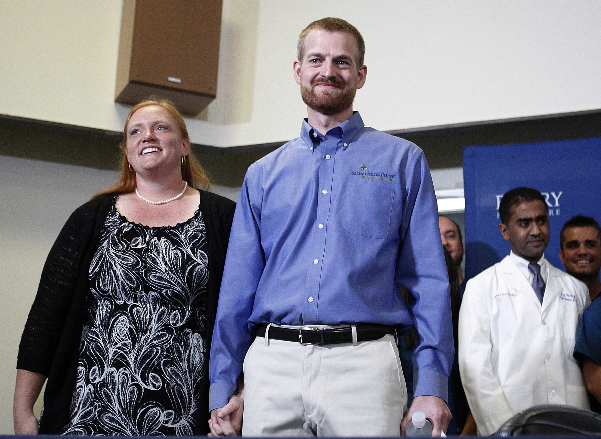 Dr. Kent Brantly, who contracted the deadly Ebola virus, stands with wife Amber during a press conference at Emory University Hospital in Atlanta on Aug. 21, 2014
