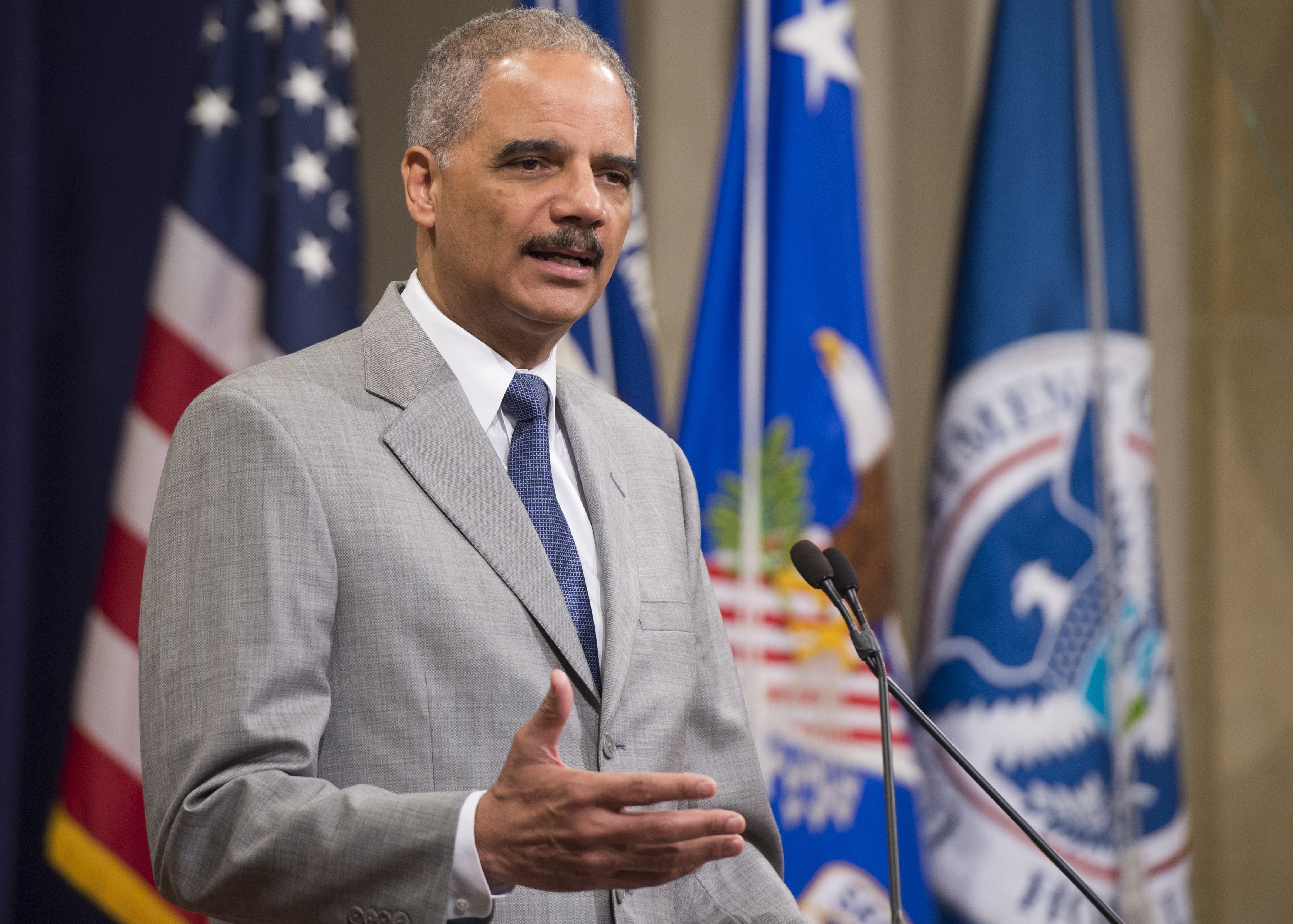 US Attorney General Eric Holder speaks during a Naturalization Ceremony at the Justice Department in Washington, DC, July 22, 2014.