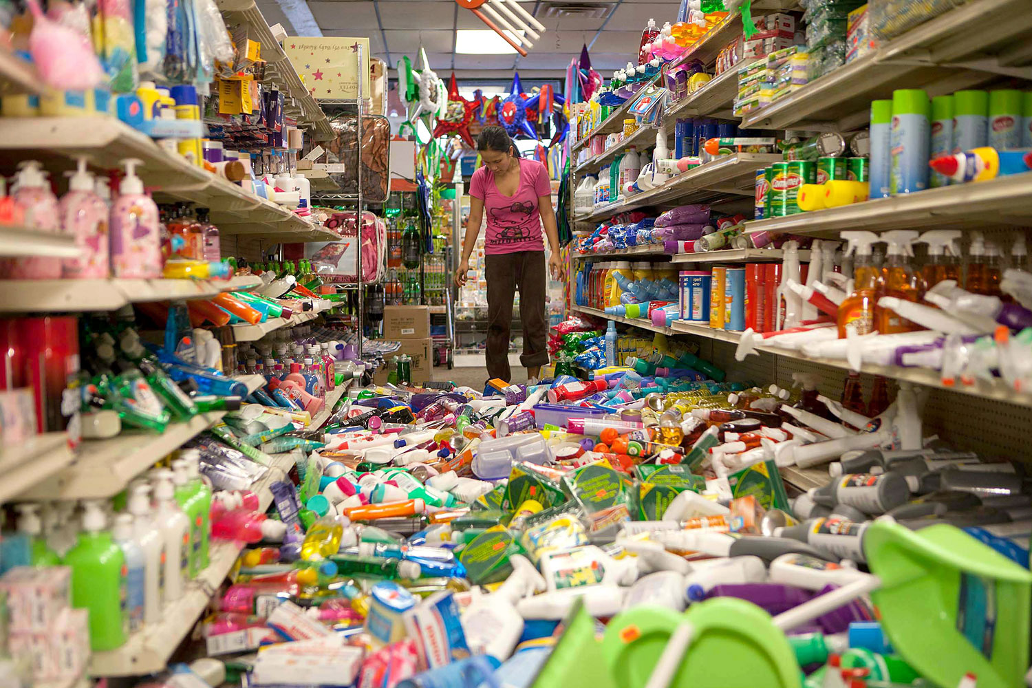 Nina Quidit cleans up the Dollar Plus and Party Supplies Store in American Canyon Calif.