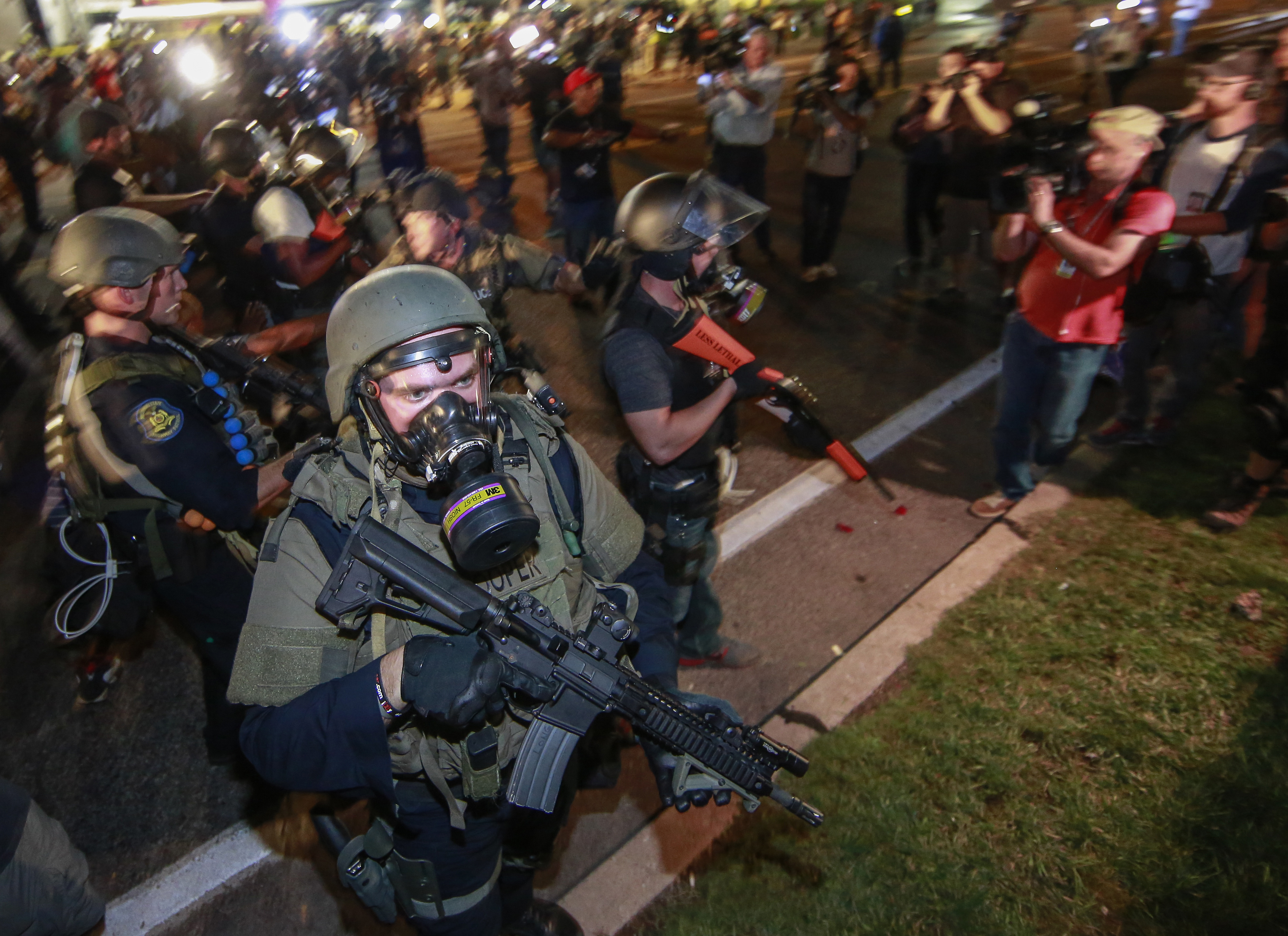 Law enforcement officers watch on during a protest on August 18, 2014 for Michael Brown, who was killed by a police officer on August 9 in Ferguson, United States.