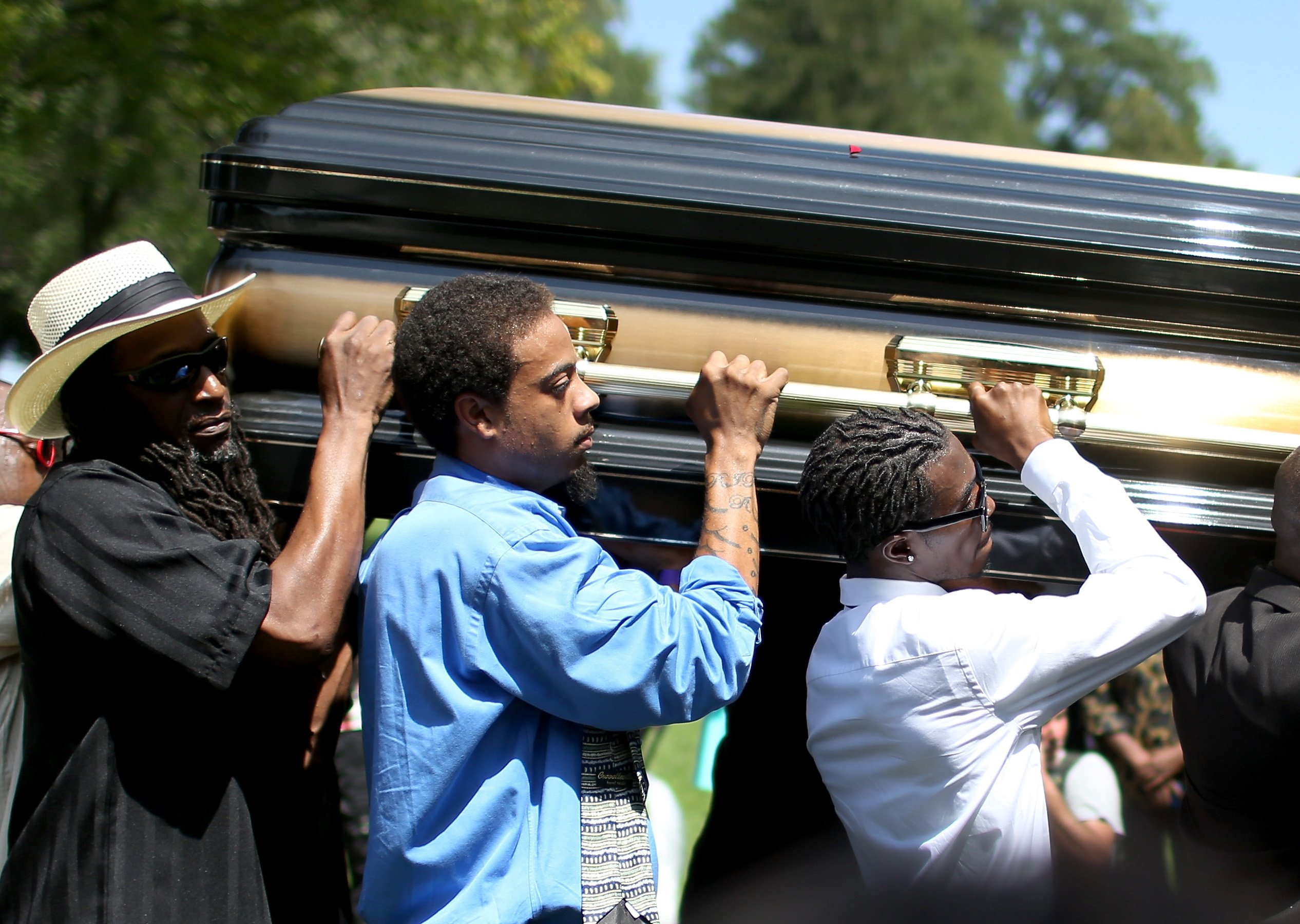 Pallbearers carry the casket of Michael Brown at St. Peter's Cemetery in St. Louis on Aug. 25, 2014.
