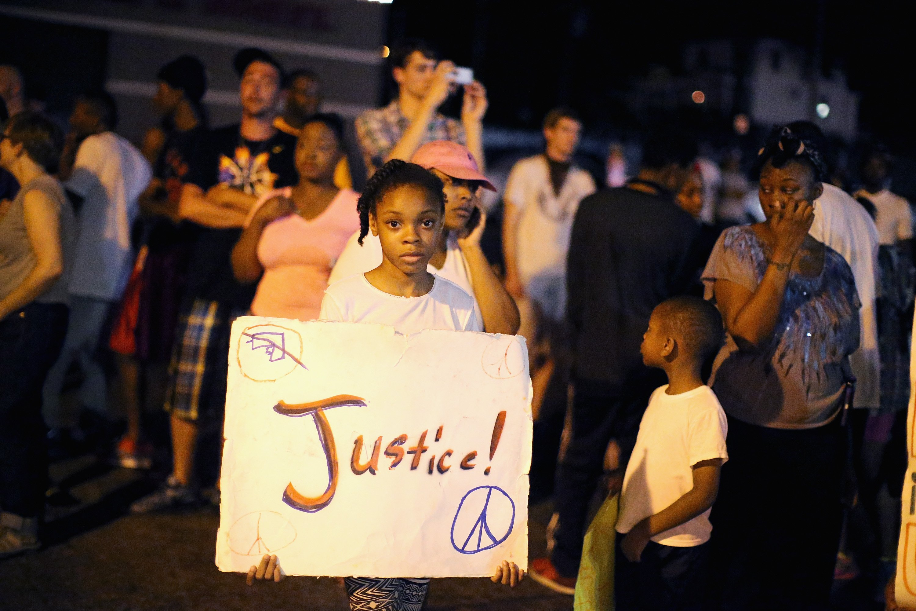 Demonstrators protest the death of Michael Brown on Aug. 22, 2014 in Ferguson, Mo.