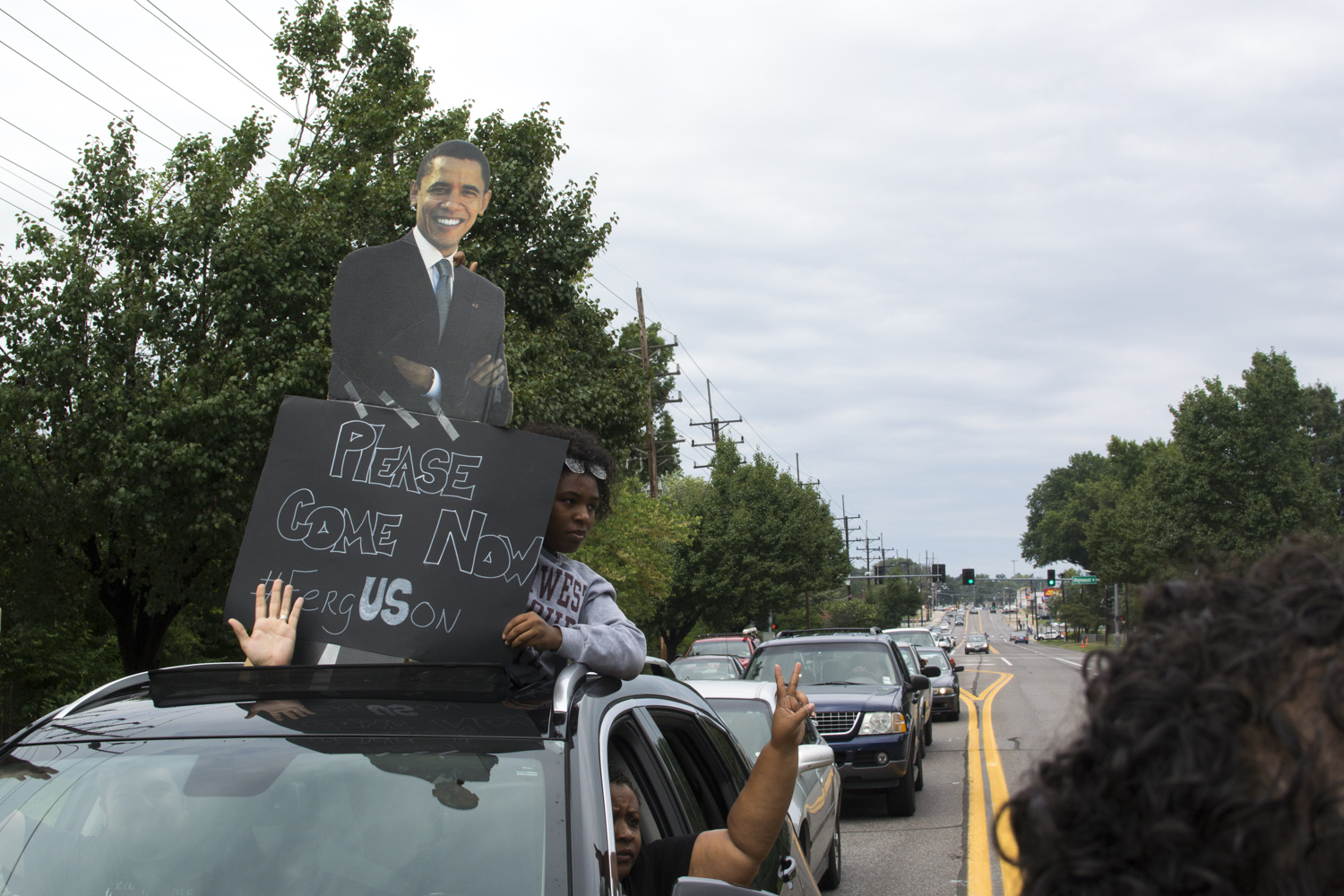 Protestors call for President Barack Obama to come to Ferguson during a peaceful rally in Ferguson, Mo. on Aug. 16, 2014.