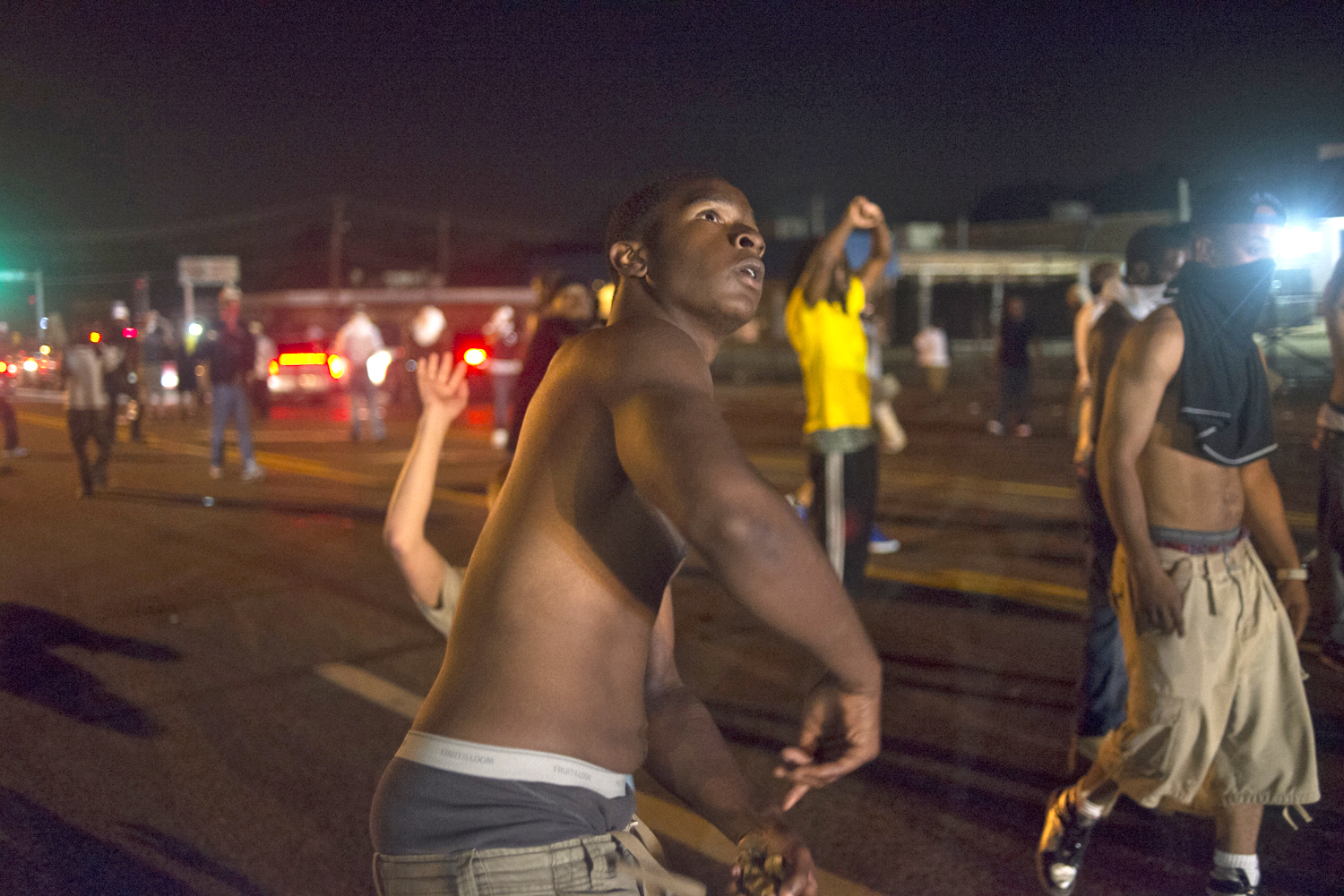 A protestor retaliates against police during violent clashes in Ferguson, Mo. on Aug. 17, 2014.