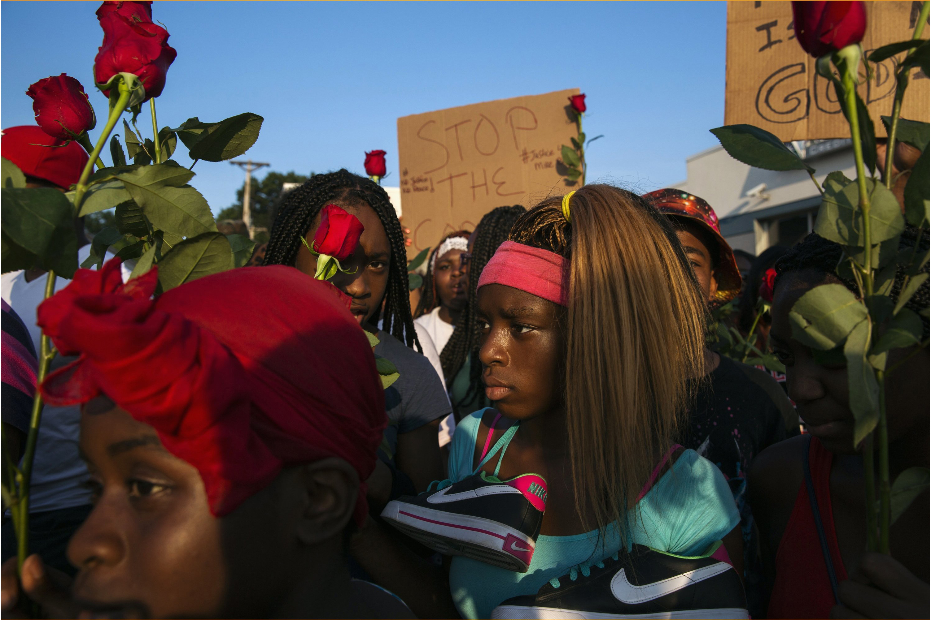 Demonstrators march down West Florissant during a peaceful march in reaction to the shooting of Michael Brown, near Ferguson, Mo. on Aug. 18, 2014.