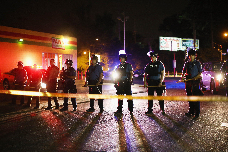Riot police lock down a neighborhood in Ferguson, Mo. on Aug. 11, 2014.