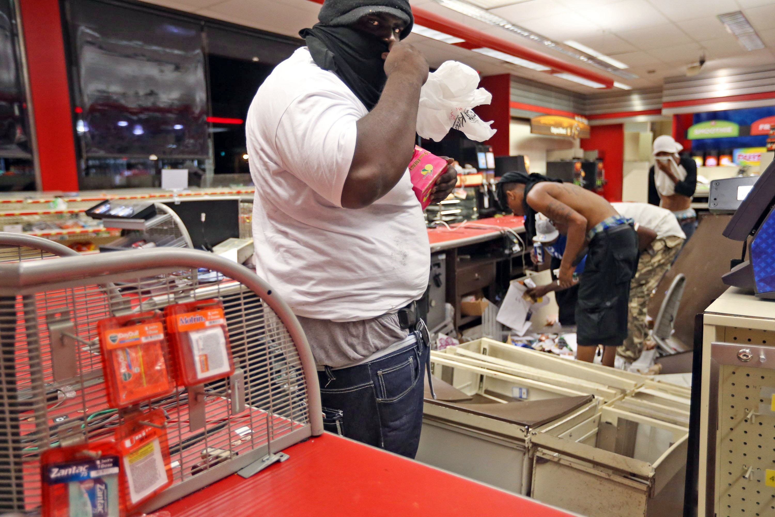 People are seen looting in a store in Ferguson, Mo. on Aug. 10, 2014.