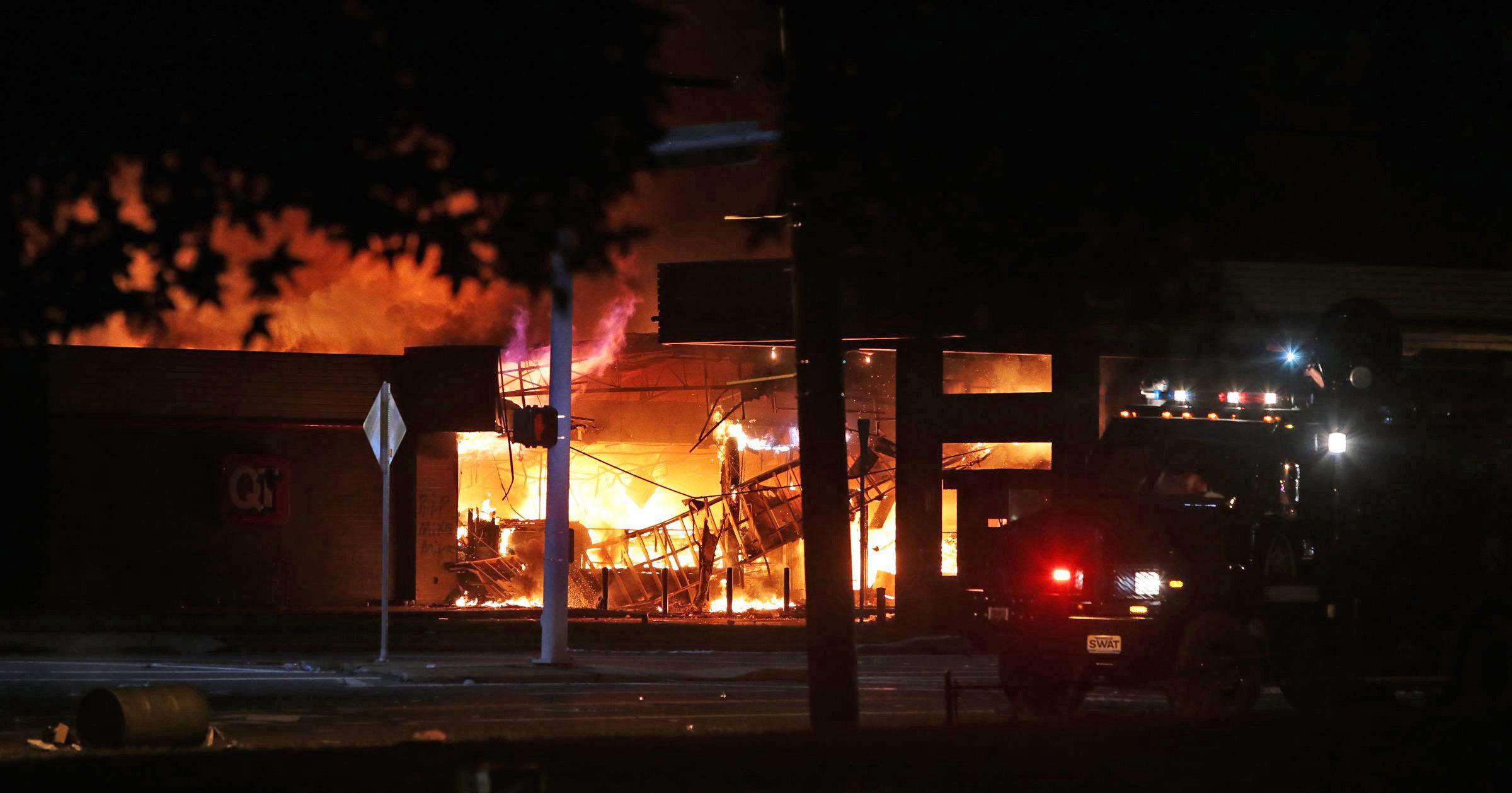 A fire is seen in Ferguson, Mo. on Aug. 10, 2014.