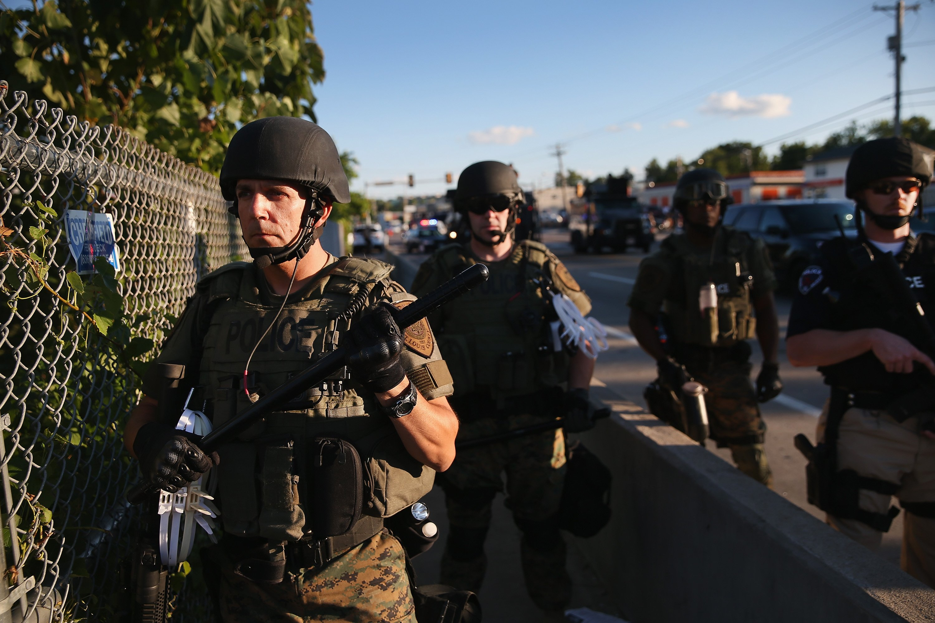Police take up position to control demonstrators who were protesting the killing of teenager Michael Brown in Ferguson, Mo. on Aug. 12, 2014.