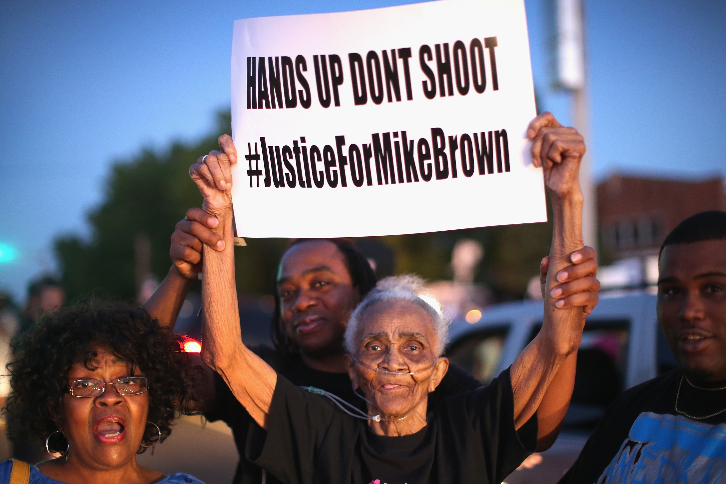 Eighty-eight-year-old Creola McCalister joins other demonstrators protesting the killing of teenager Michael Brown outside Greater St. Marks Family Church with Brown's family and with civil rights leader Rev. Al Sharpton in St. Louis on  Aug. 12, 2014.