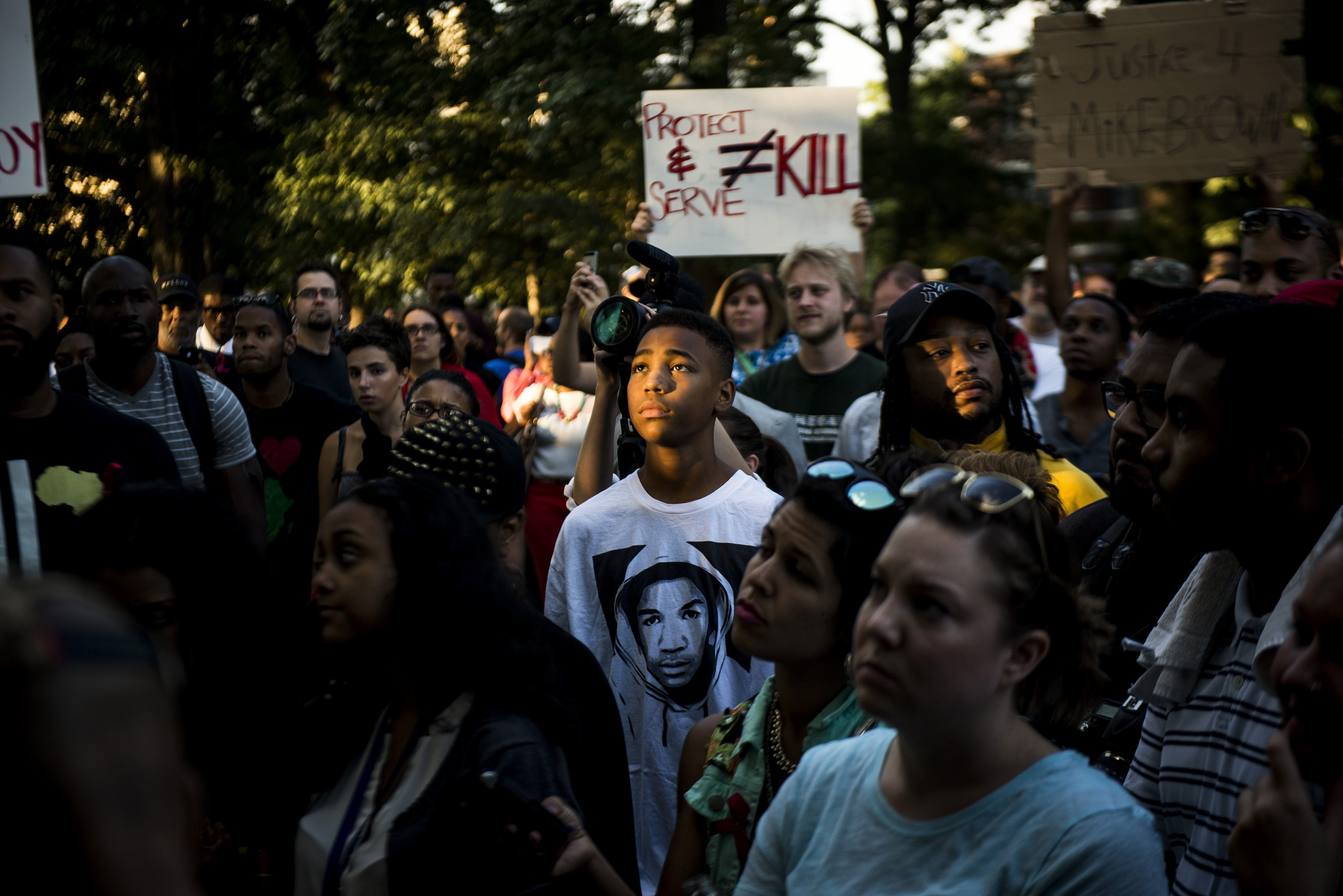 A demonstrator wearing a Trayvon Martin T-shirt stands with others in Washington D.C. to express solidarity with protesters in Ferguson, Mo., Aug. 14, 2014.