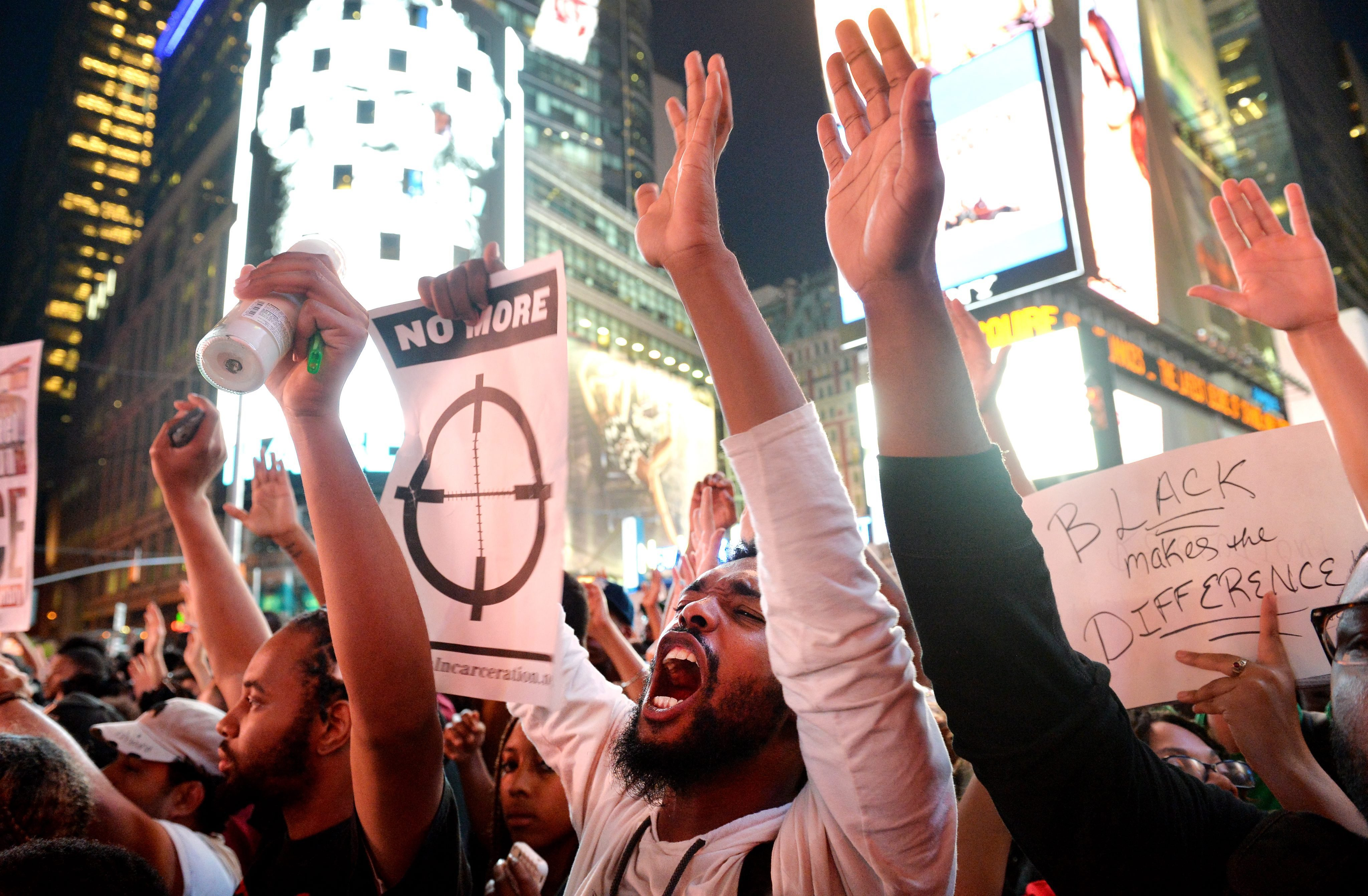 People chant during a march in Times Square on Aug. 14, 2014 that sprung from a National Day of Silence in Remembrance of Mike Brown, an unarmed young man who was killed on Aug. 9, 2014 in Ferguson, Missouri.