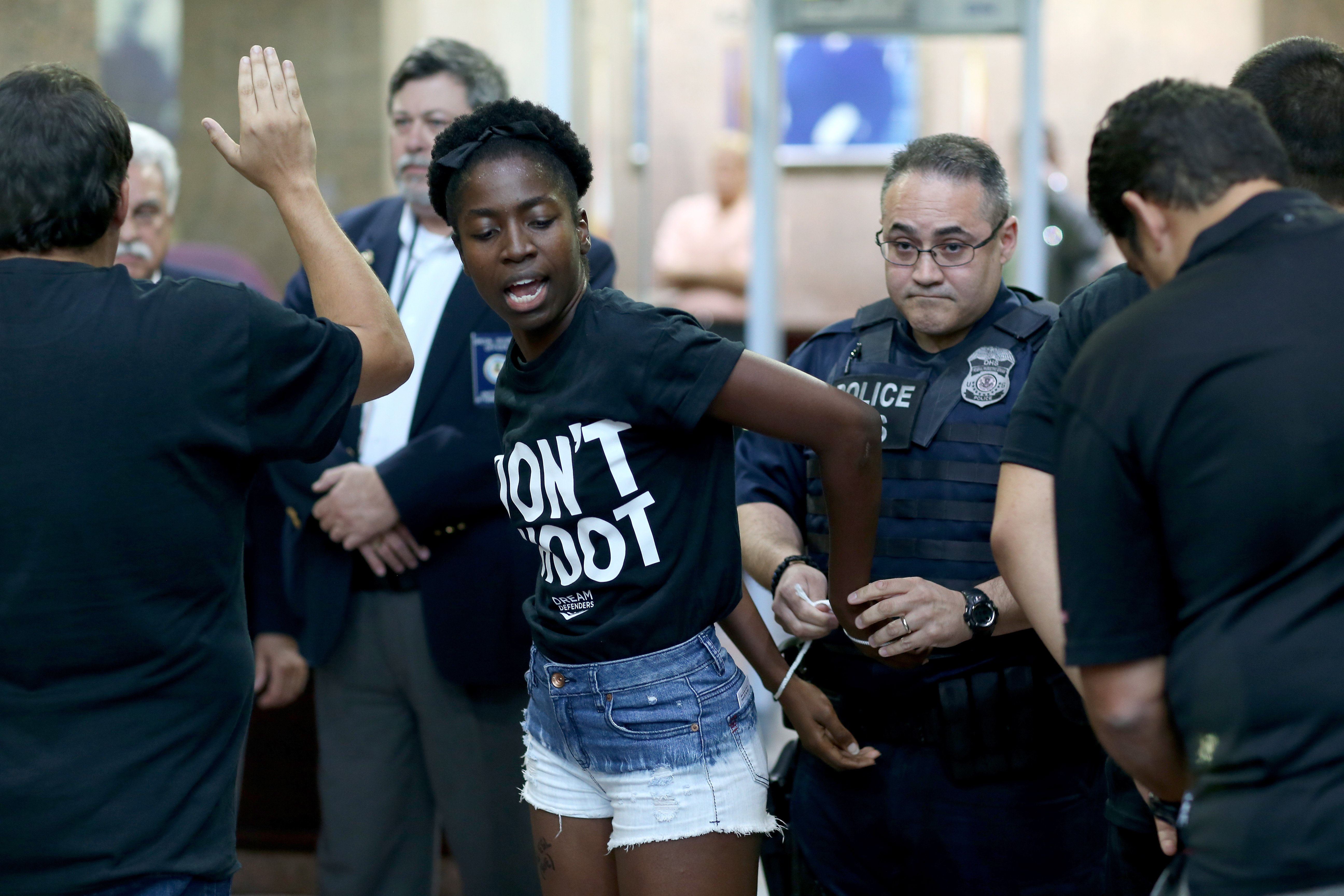 Marie Paul is arrested by police in the James Lawrence King Federal Justice Building on August 14, 2014 in Miami. The protesters, which included members of the civil rights group Dream Defenders, say they want justice for Mike Brown.