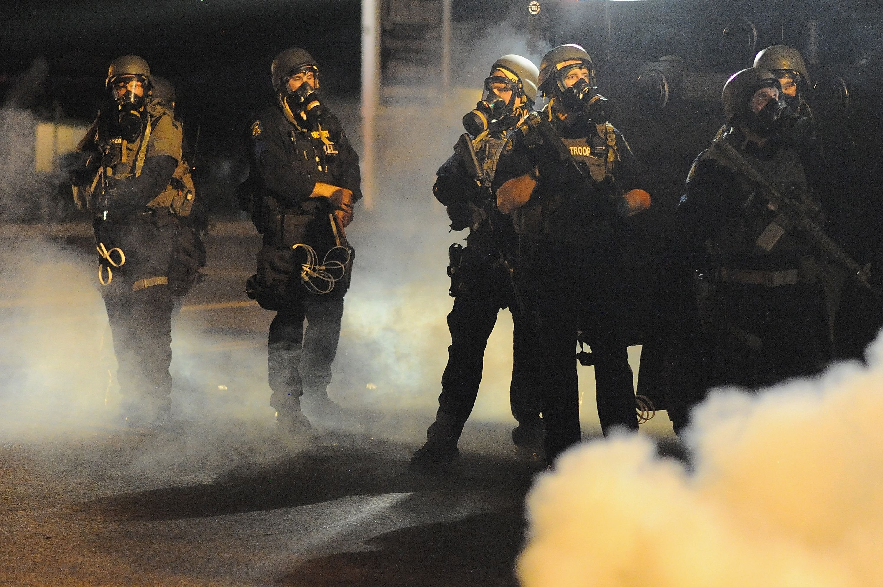 Law enforcement officers watch on during a protest on West Florissant Avenue in Ferguson, Mo. on Aug. 18, 2014.