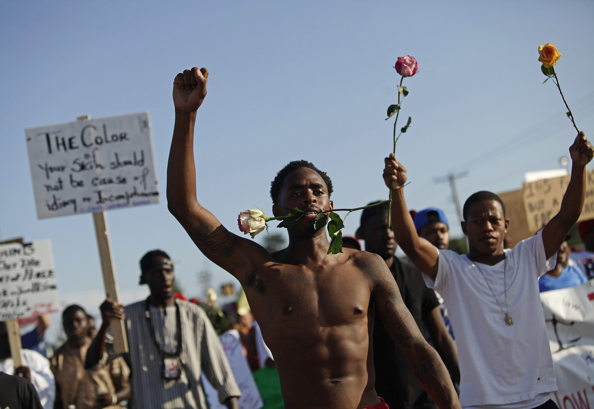 Demonstrators protest against the fatal shooting of Michael Brown in Ferguson, Mo. Aug. 19, 2014.