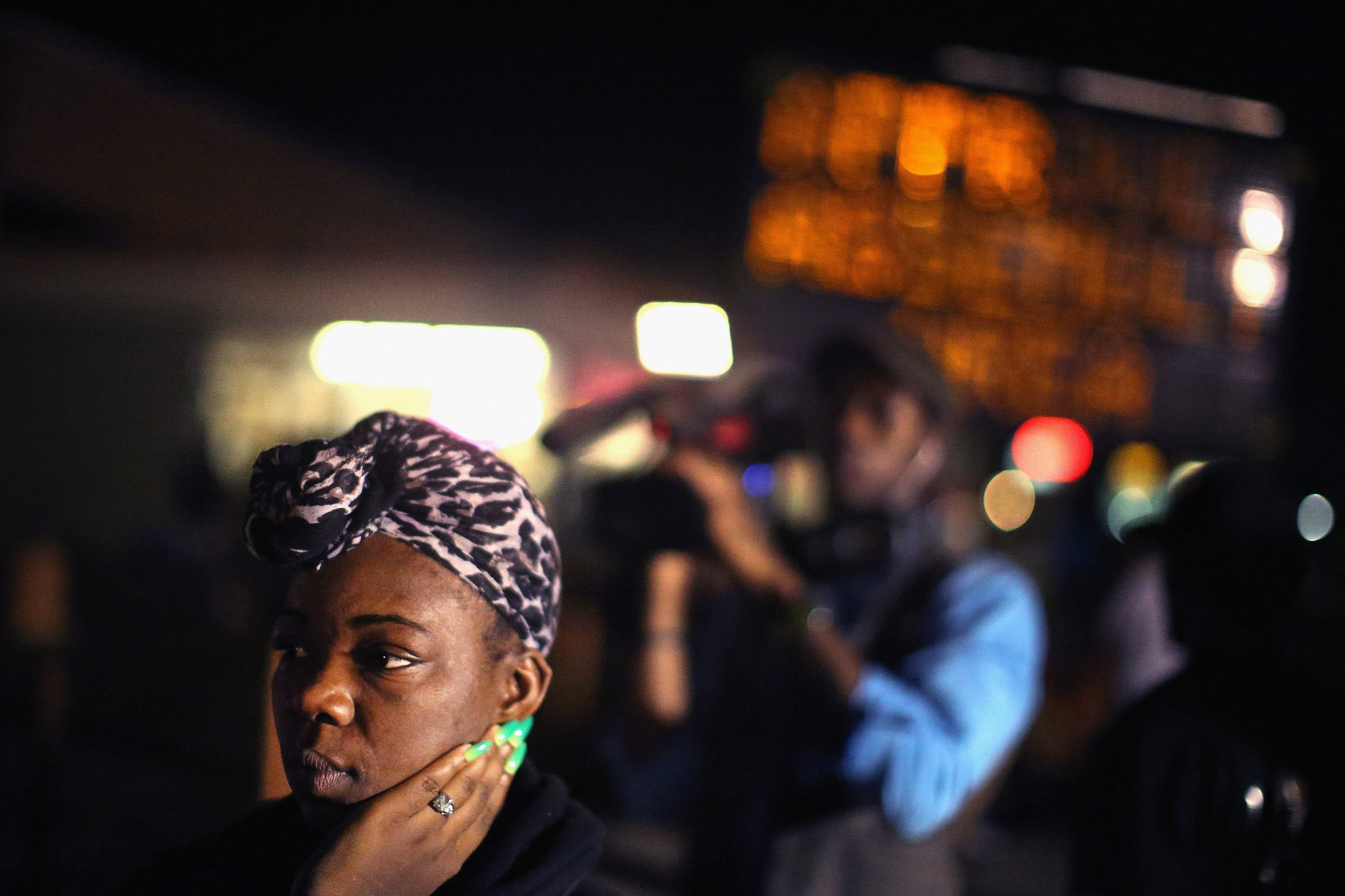 Demonstrators protest the killing of teenager Michael Brown on Aug. 20, 2014 in Ferguson, Mo.