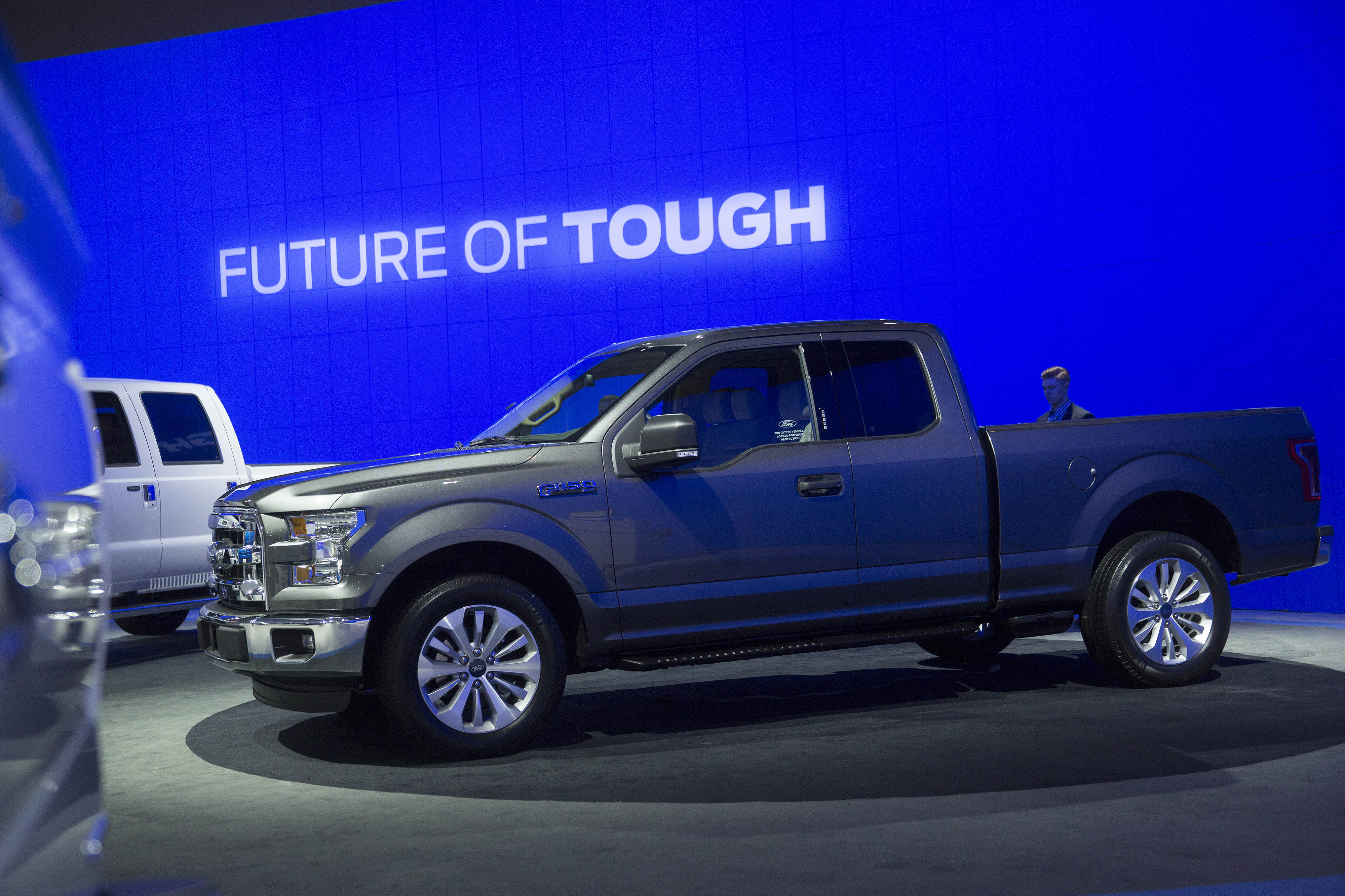 An attendee looks at the Ford Motor Co. F-150 pickup truck during the Washington Auto Show in Washington, D.C., U.S., on Wednesday, Jan. 22, 2014.