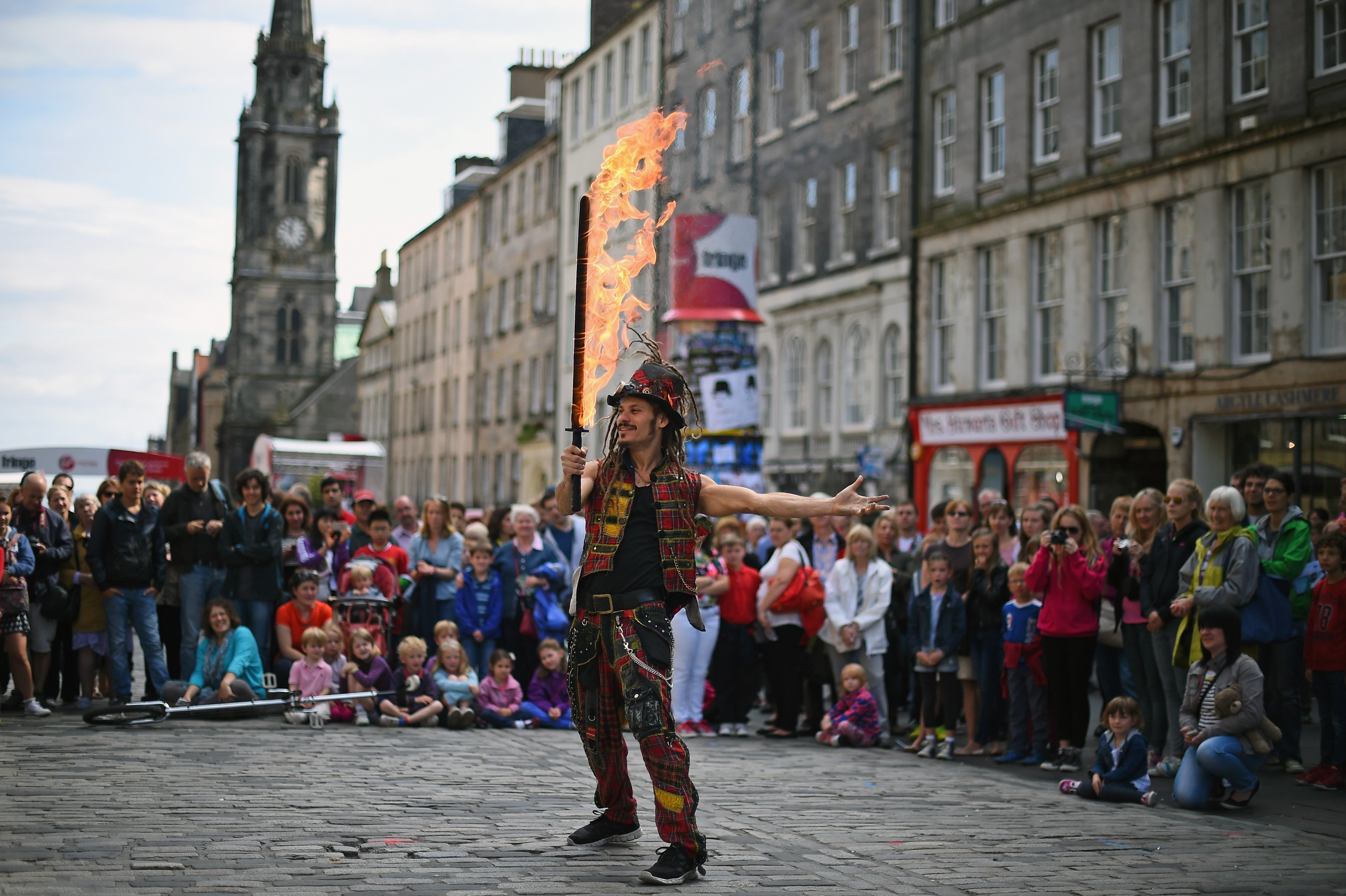 Edinburgh Festival Fringe entertainers perform on the Royal Mile on August 14, 2014 in Edinburgh, Scotland. The largest performing arts festival in the world, this year's festival hosts more than 3,000 shows in nearly 300 venues across the city.