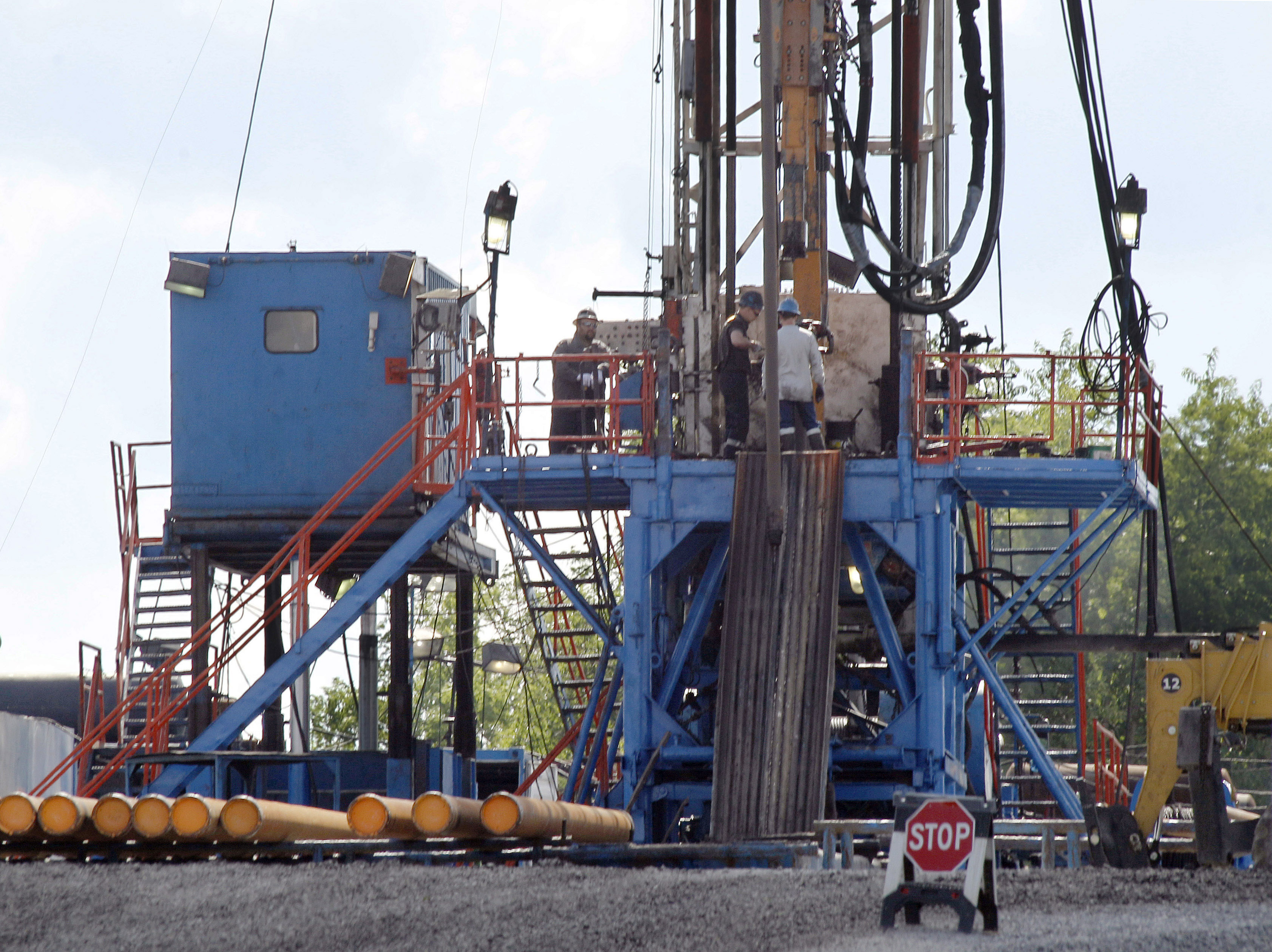 A crew works on a gas drilling rig at a well site for shale based natural gas in Zelienople, Pa on Feb. 28. 2013.