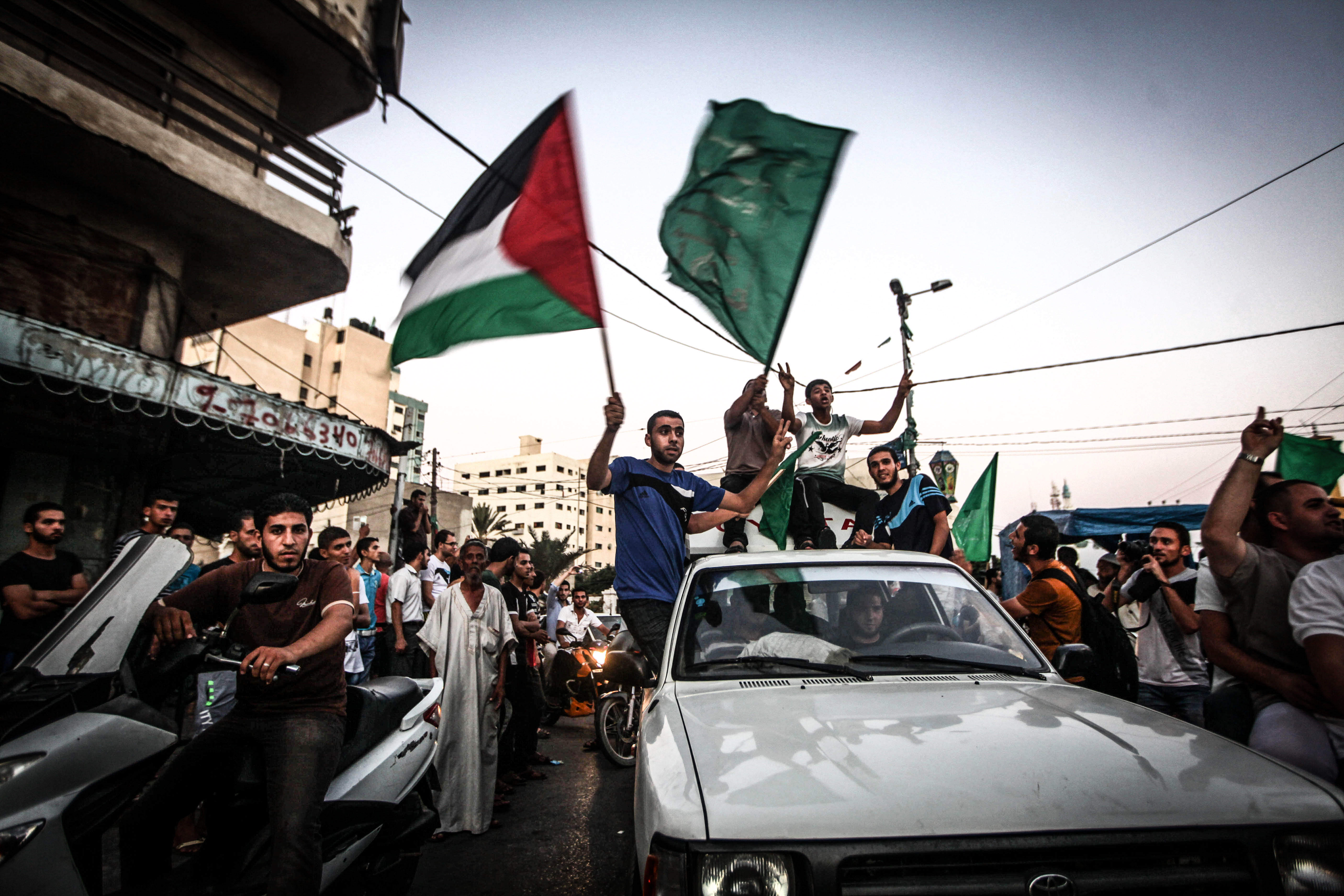 Palestinians in Gaza City celebrate in the streets after a deal had been reached between Hamas and Israel over a long-term end to seven weeks of fighting in the Gaza Strip on Aug. 26, 2014