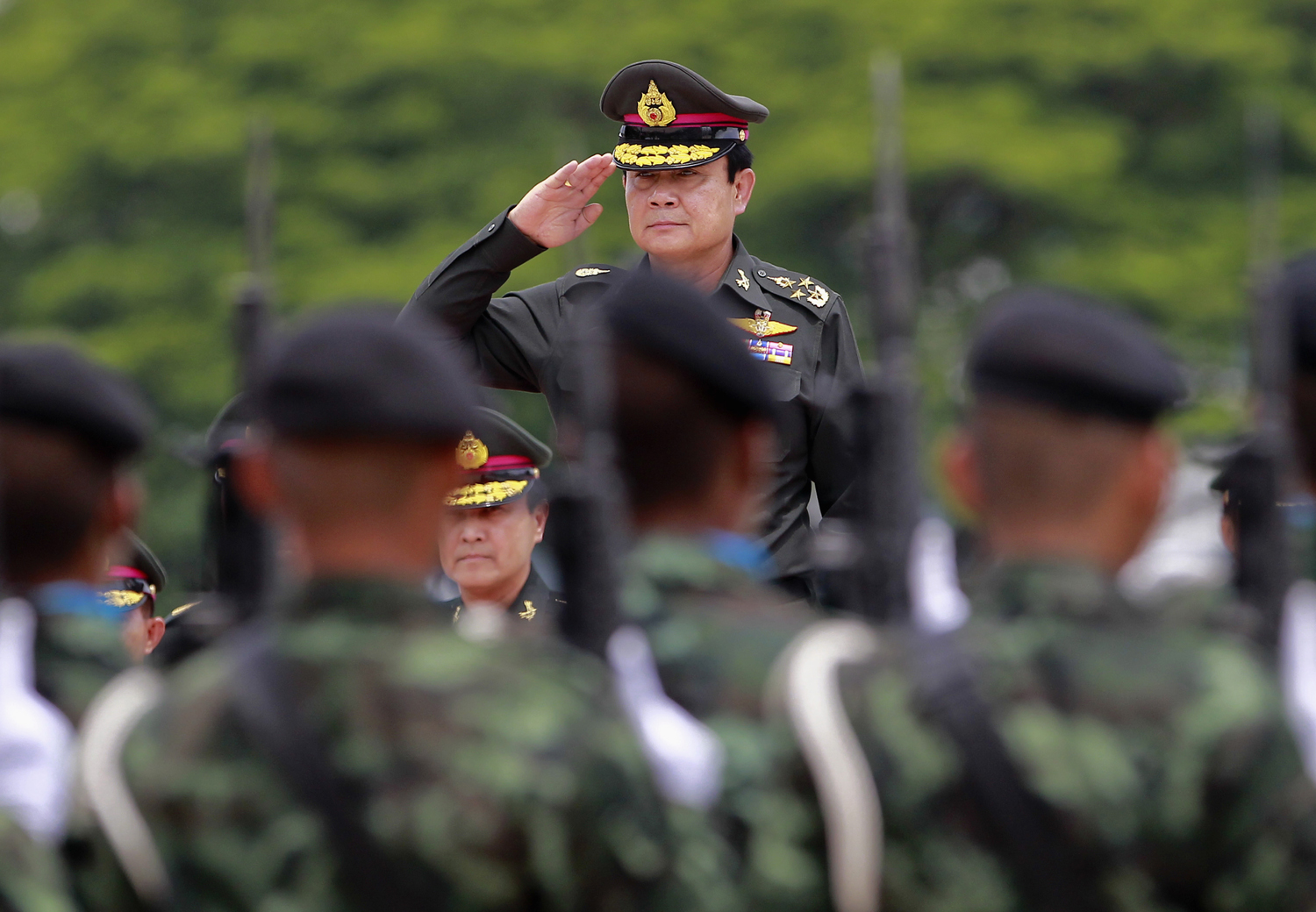 Thailand's newly appointed Prime Minister Prayuth Chan-ocha reviews honor guards during a military ceremony in Chonburi province, on the outskirts of Bangkok on August 21, 2014.