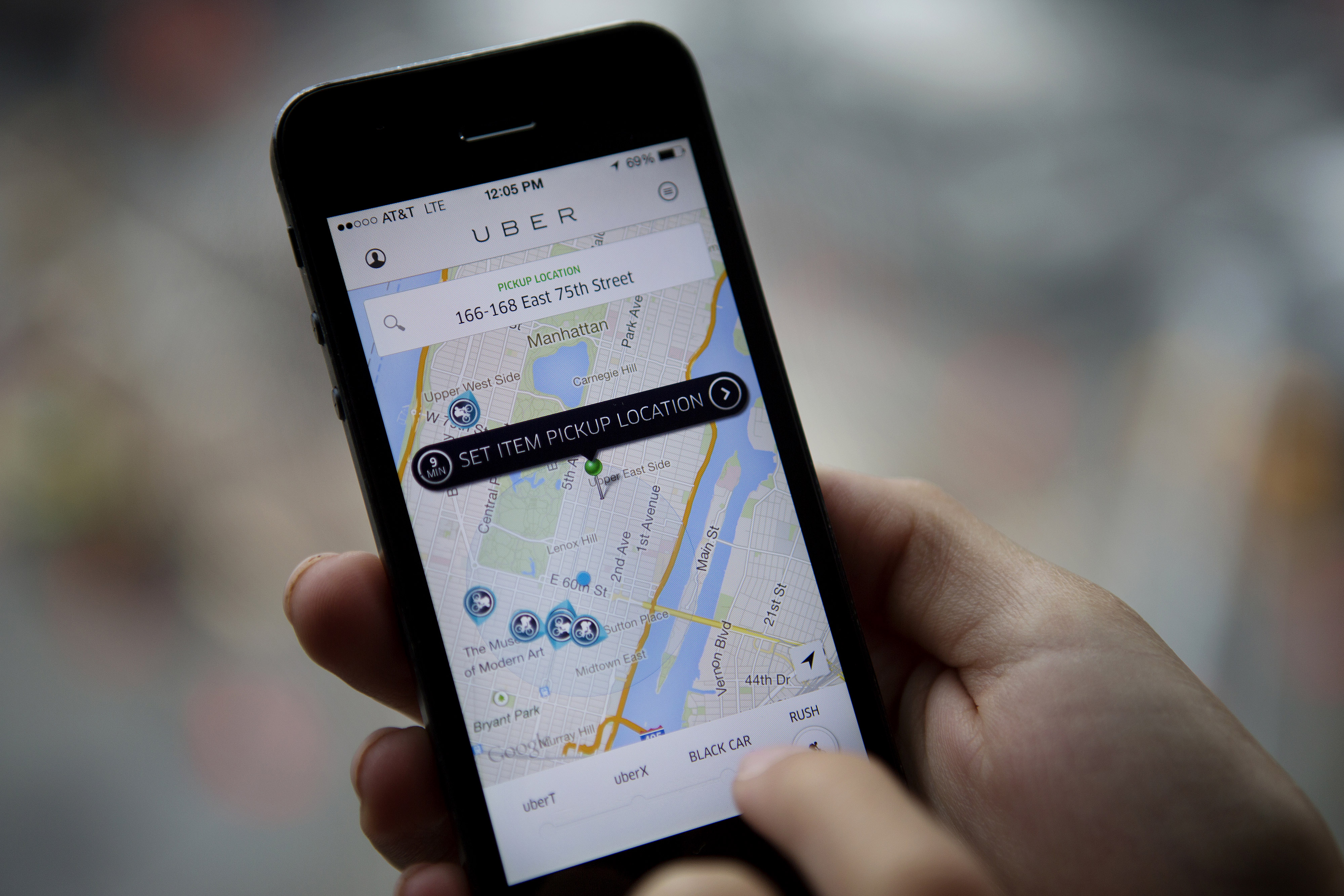Th Uber Technologies Inc. car service application (app) is demonstrated for a photograph on an Apple Inc. iPhone in New York, U.S., on Wednesday, Aug. 6, 2014.